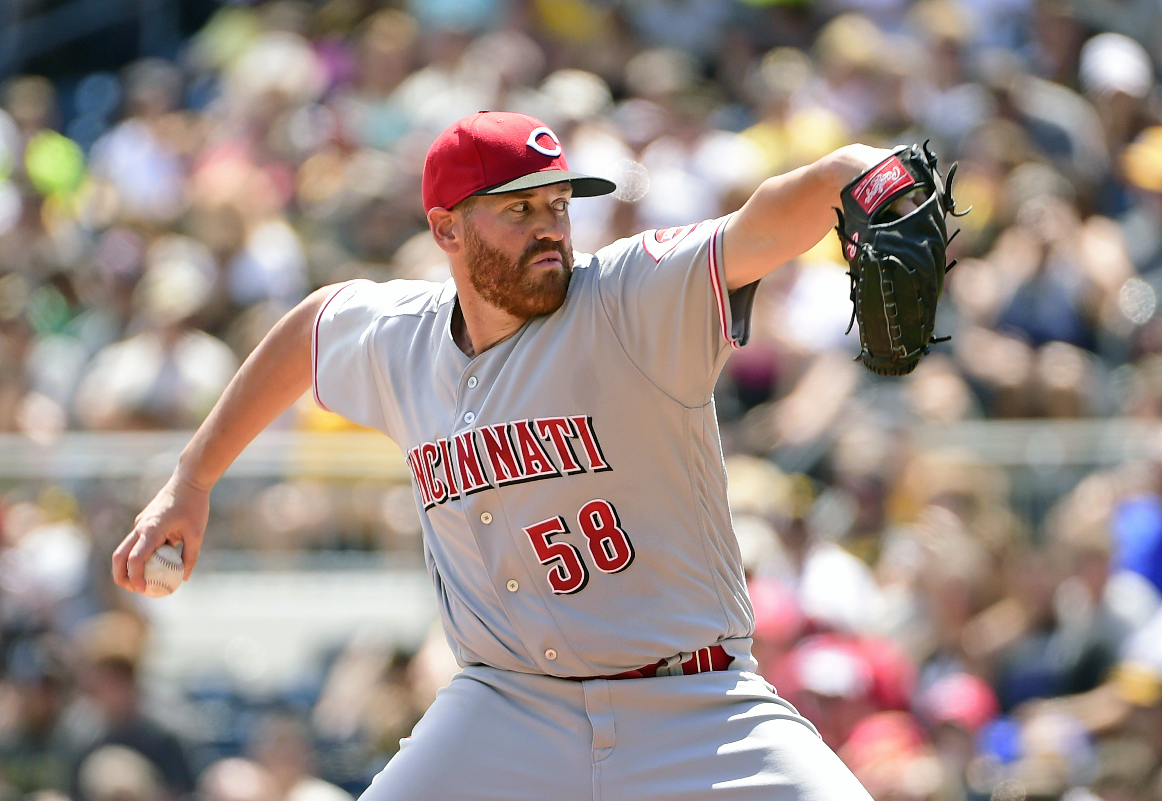 Cincinnati Reds starting pitcher Dan Straily (58) throws in the first inning of a baseball game against the Pittsburgh Pirates in Pittsburgh, Sunday, Aug. 7, 2016. (AP Photo/Fred Vuich)