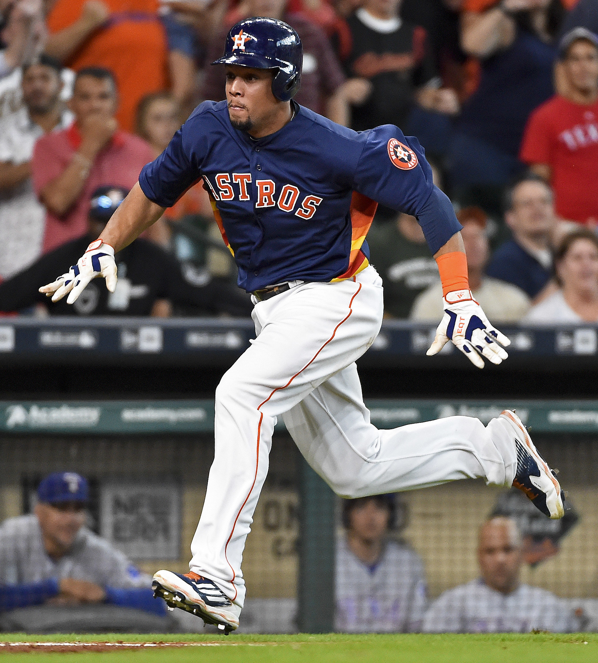 Houston Astros pinch-runner Carlos Gomez runs to home to score the tying run on Tony Kemp's single in the ninth inning of a baseball game against the Texas Rangers, Sunday, Aug. 7, 2016, in Houston. (AP Photo/Eric Christian Smith)