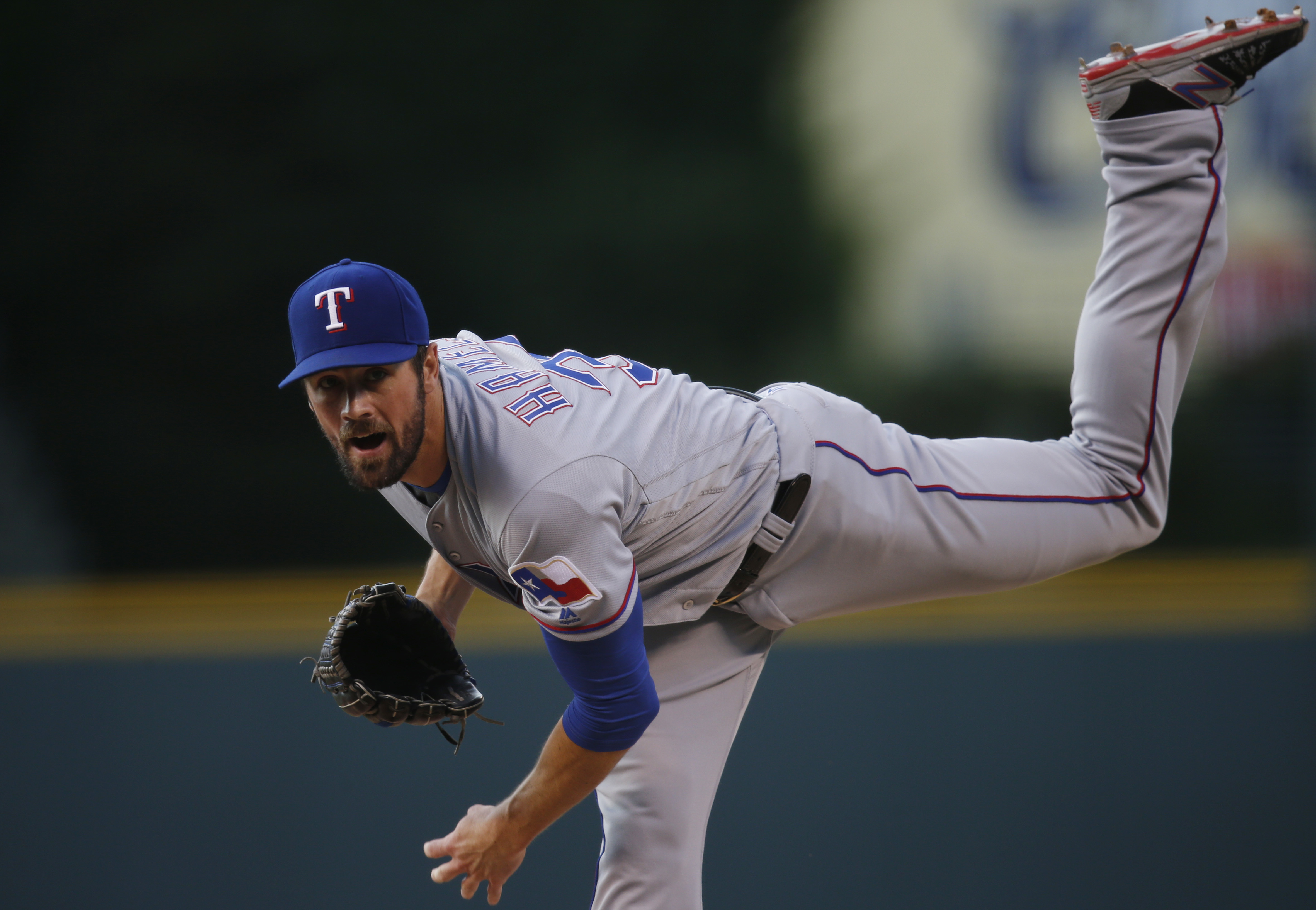 Texas Rangers starting pitcher Cole Hamels delivers a pitch to Colorado Rockies' DJ LeMahieu in the first inning of a baseball game, Monday, Aug. 8, 2016 in Denver. (AP Photo/David Zalubowski)