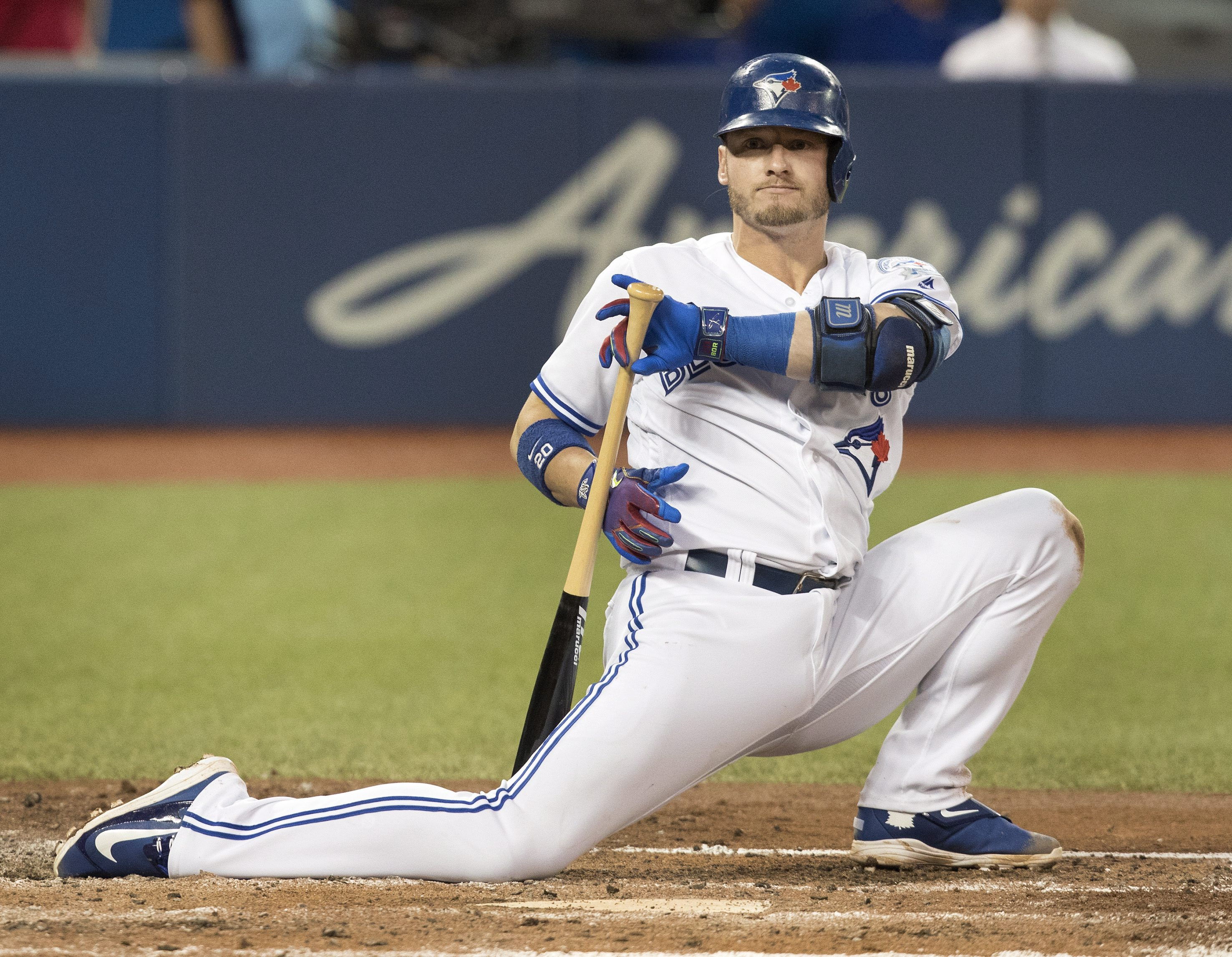 Toronto Blue Jays' Josh Donaldson drops to one knee after being backed off by a pitch in the fourth inning of their baseball game against the Tampa Bay Rays in Toronto on Monday, Aug. 8, 2016. (Fred Thornhill/The Canadian Press via AP)