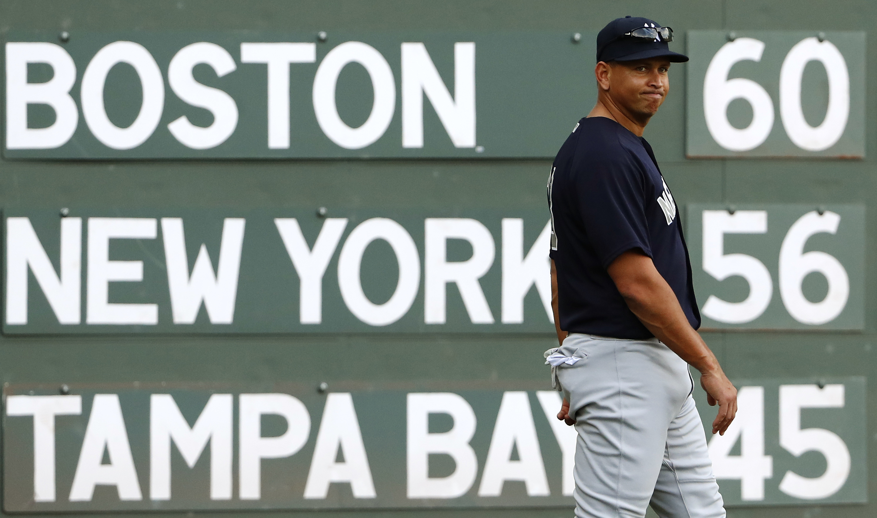 New York Yankees' Alex Rodriguez walks past the scoreboard before the Yankees' baseball game against the Boston Red Sox at Fenway Park in Boston on Tuesday, Aug. 9, 2016. (AP Photo/Winslow Townson)