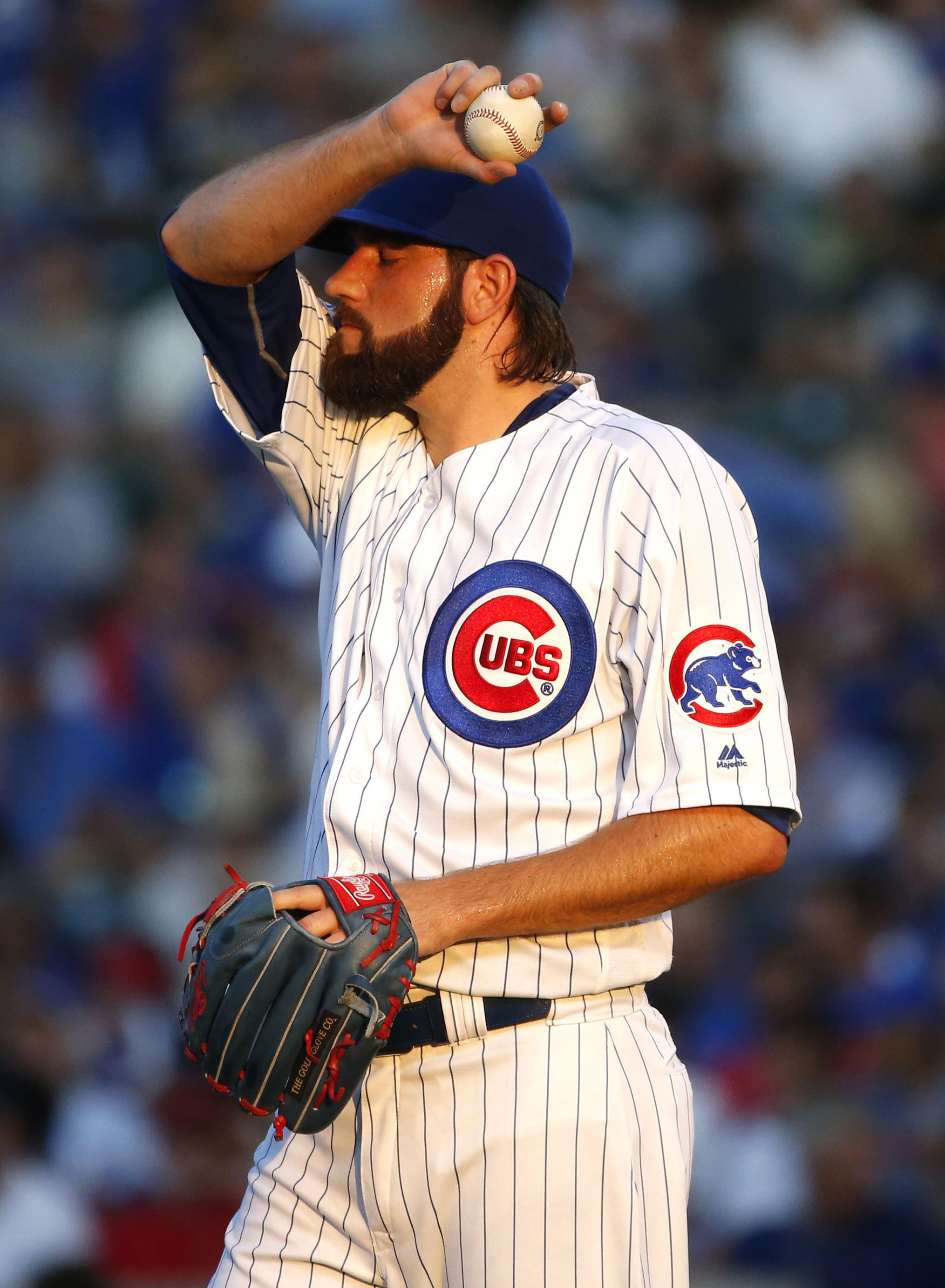 Chicago Cubs starter Jason Hammel wipes his face during the first inning of the team's baseball game against the Los Angeles Angels in Chicago, Wednesday, Aug. 10, 2016. (AP Photo/Nam Y. Huh)