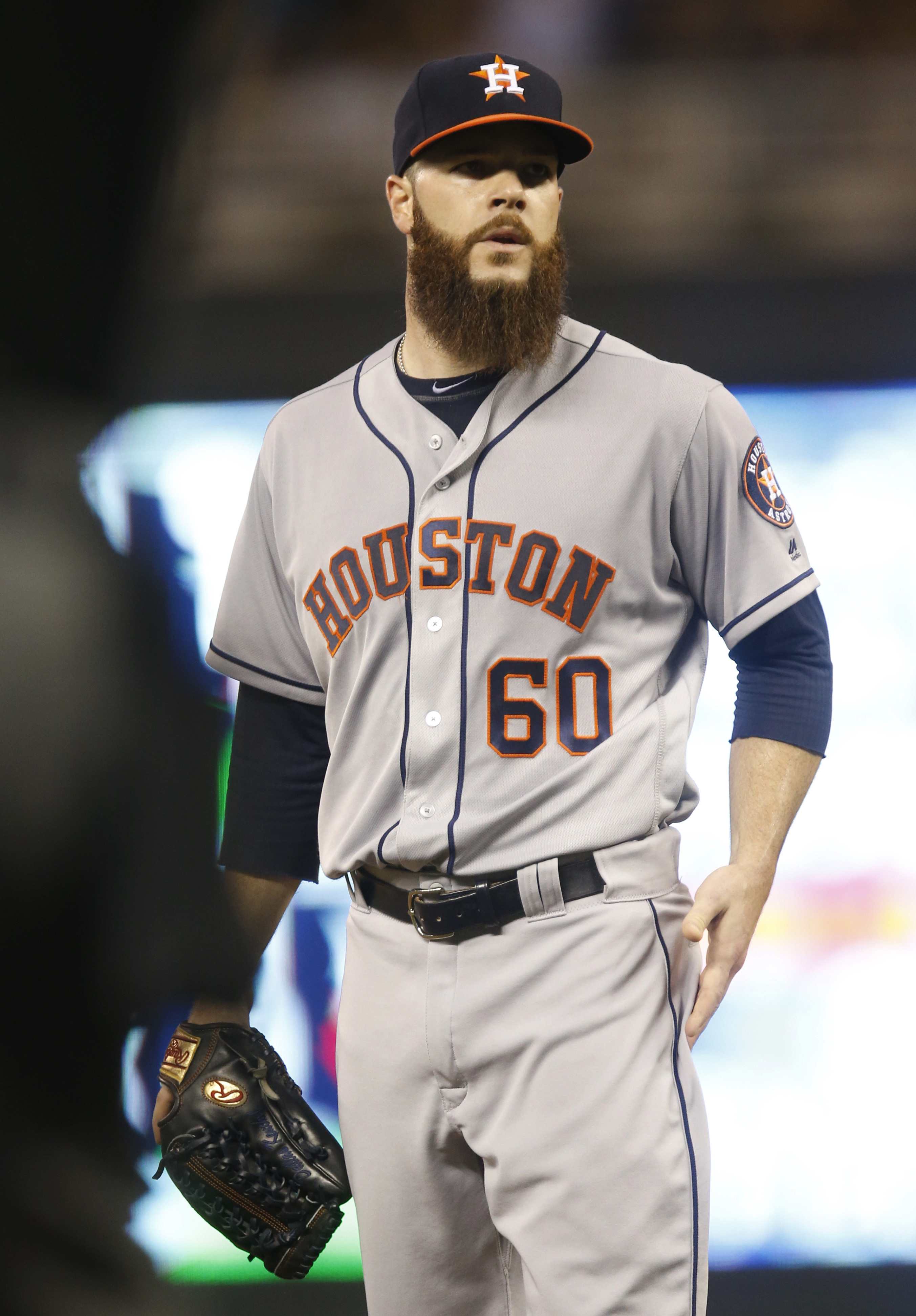 Houston Astros pitcher Dallas Keuchel gives up a solo home run to Minnesota Twins' Brian Dozier in the first inning of a baseball game Wednesday, Aug. 10, 2016 in Minneapolis. (AP Photo/Jim Mone)