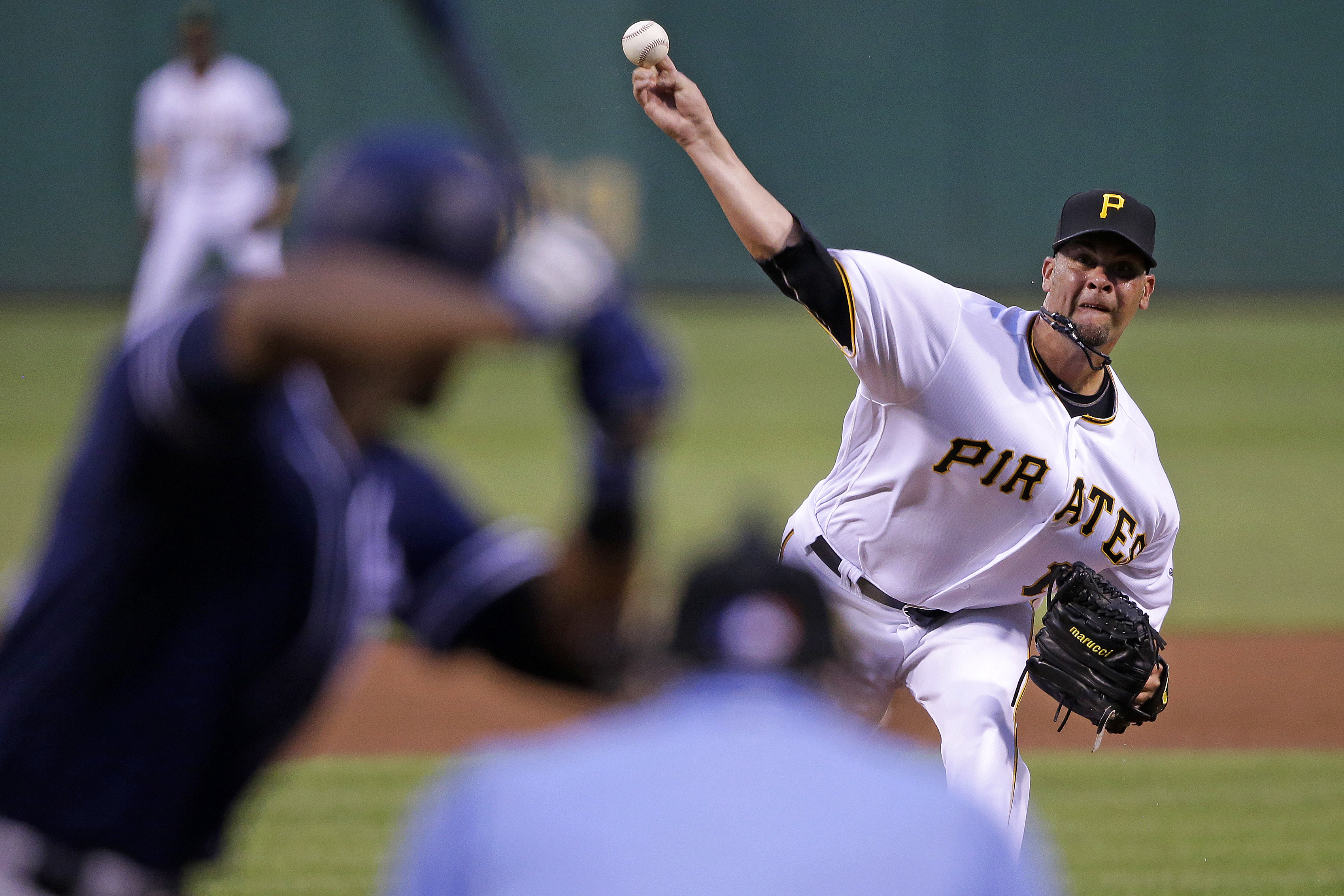 Pittsburgh Pirates starting pitcher Ryan Vogelsong delivers a pitch in the fourth inning of a baseball game against the San Diego Padres in Pittsburgh, Wednesday, Aug. 10, 2016. (AP Photo/Gene J. Puskar)