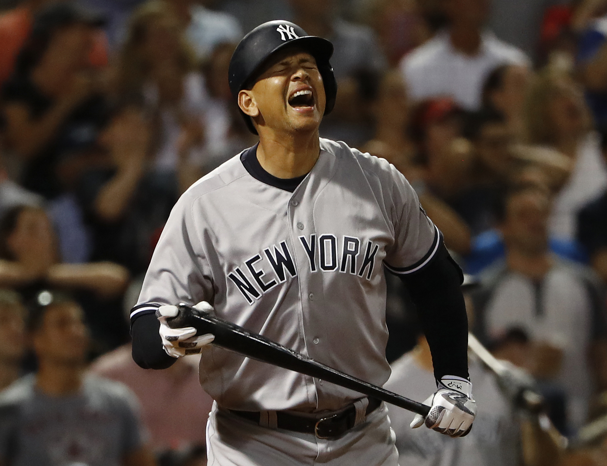 New York Yankees' Alex Rodriguez reacts to flying out as a pinch hitter during the seventh inning of a baseball game against the Boston Red Sox at Fenway Park in Boston on Wednesday, Aug. 10, 2016. (AP Photo/Winslow Townson)