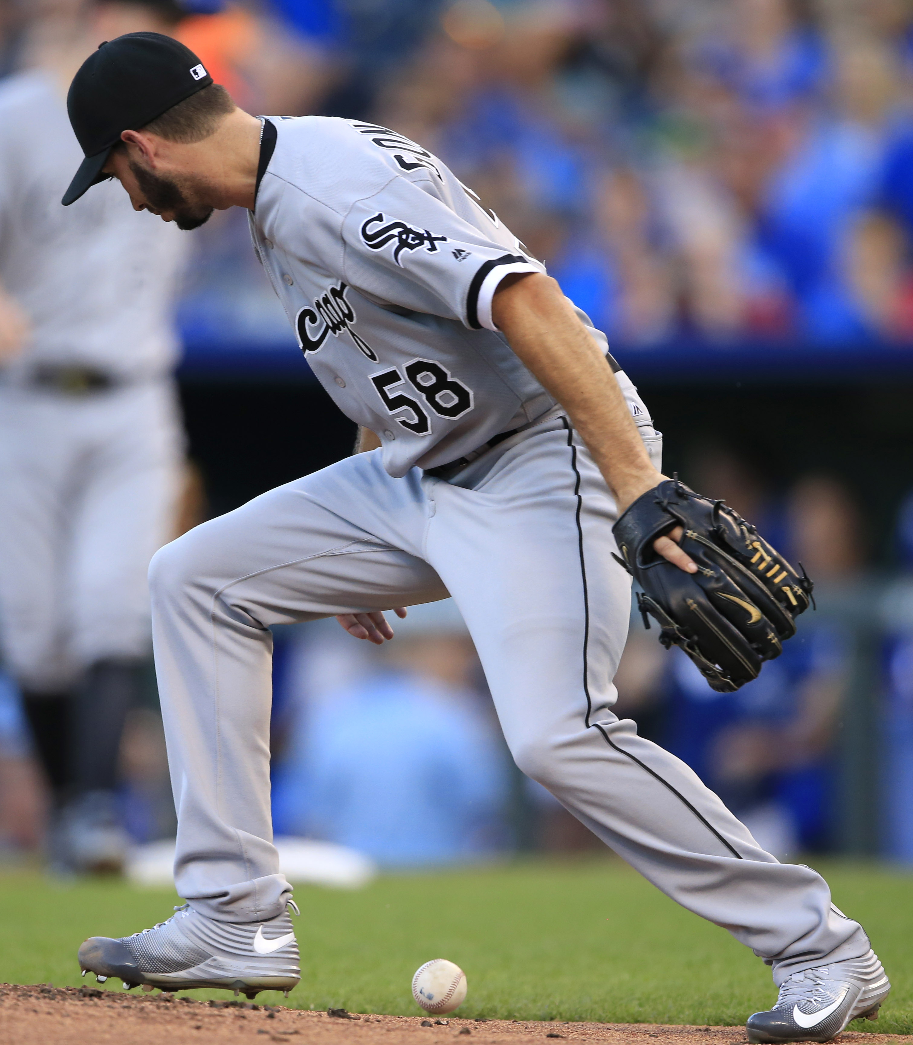 Chicago White Sox starting pitcher Miguel Gonzalez knocks down a ball hit by Kansas City Royals' Eric Hosmer during the first inning of a baseball game at Kauffman Stadium in Kansas City, Mo., Thursday, Aug. 11, 2016. Gonzalez threw out Hosmer at first ba