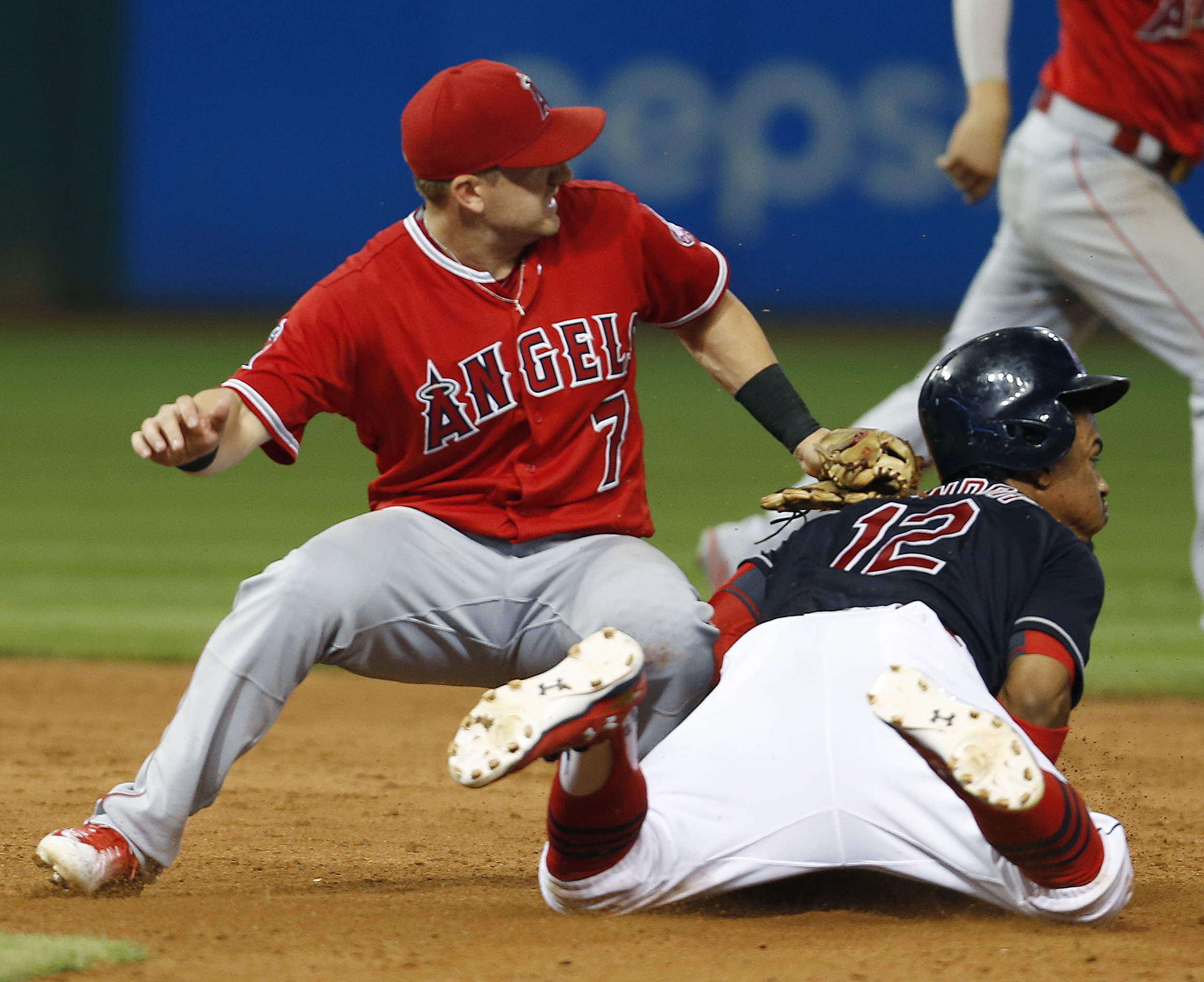 Cleveland Indians' Francisco Lindor (12) steals second base as Los Angeles Angels' Cliff Pennington (7) covers during the sixth inning of a baseball game Friday, Aug. 12, 2016, in Cleveland. Lindor's stolen base was the team's eighth of the game. (AP Phot