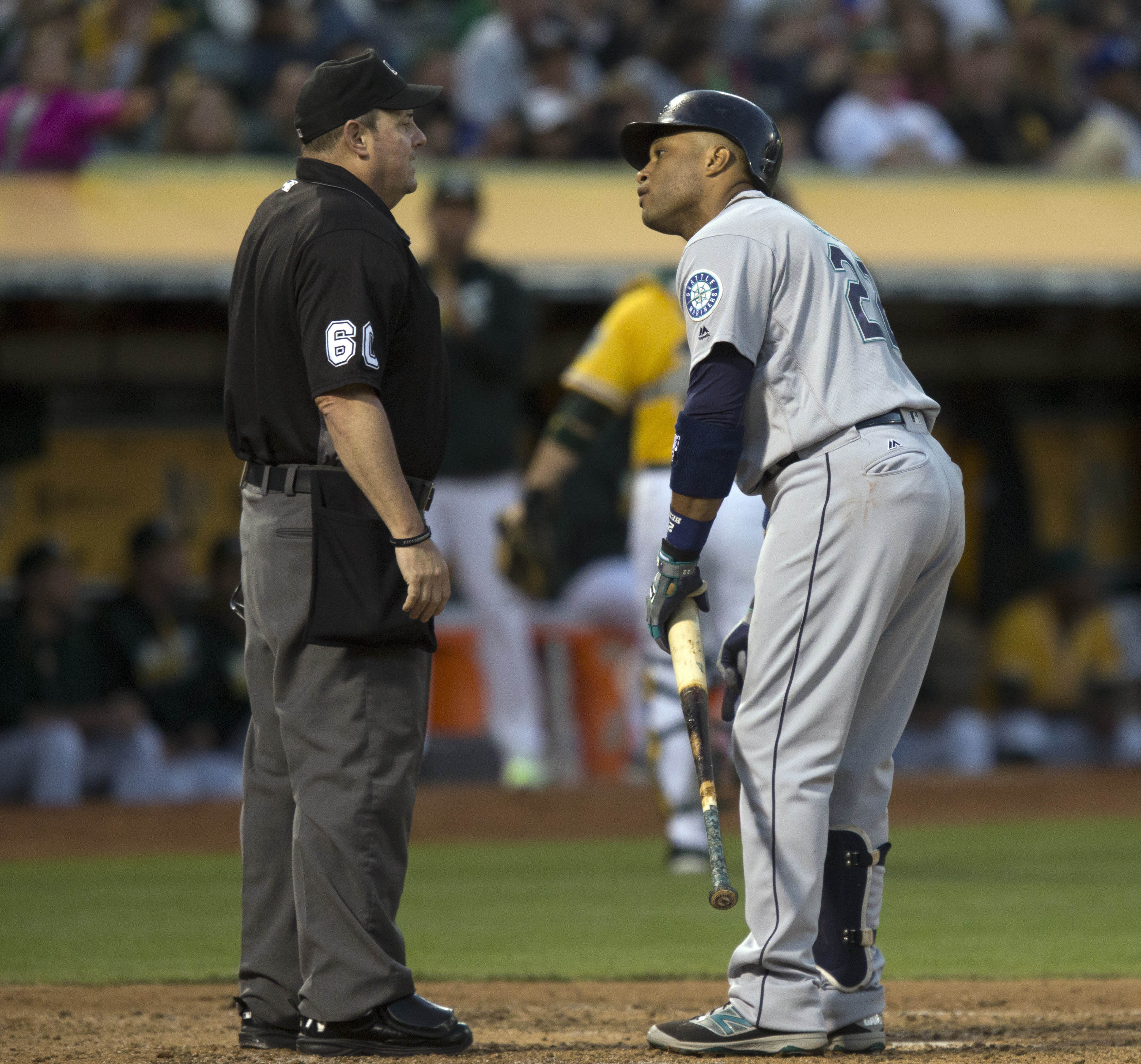 Seattle Mariners' Robinson Cano argues with home plate umpire Marty Foster after being called out on strikes during the fourth inning of a baseball game against the Oakland Athletics, Friday, Aug. 12, 2016, in Oakland, Calif. (AP Photo/D. Ross Cameron)