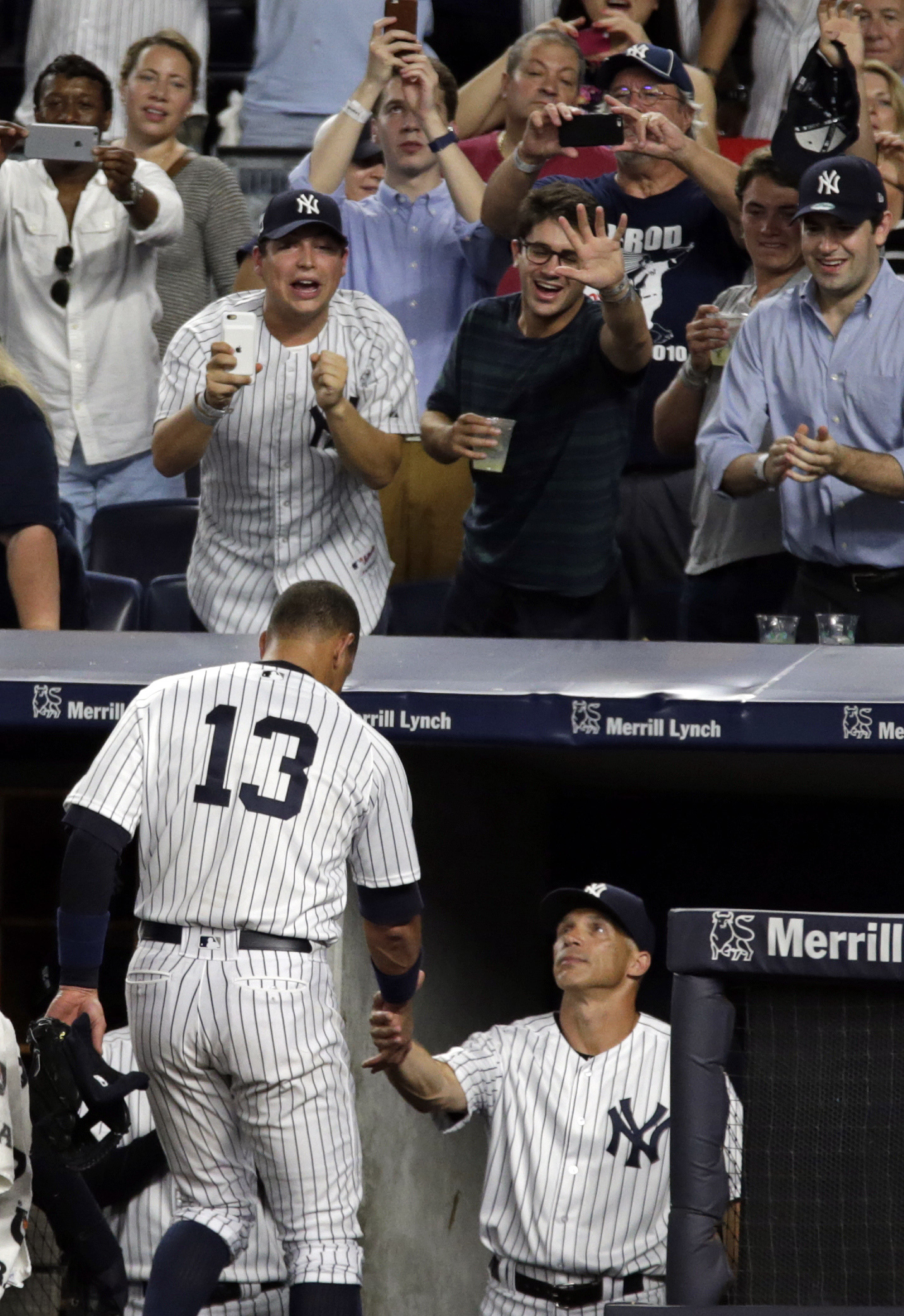 New York Yankees' Alex Rodriguez (13) shakes hands with manager Joe Girardi after being taken out of his final baseball game as a Yankee player, during the ninth inning against the Tampa Bay Rays on Friday, Aug. 12, 2016, in New York.The Yankees won 6-3.