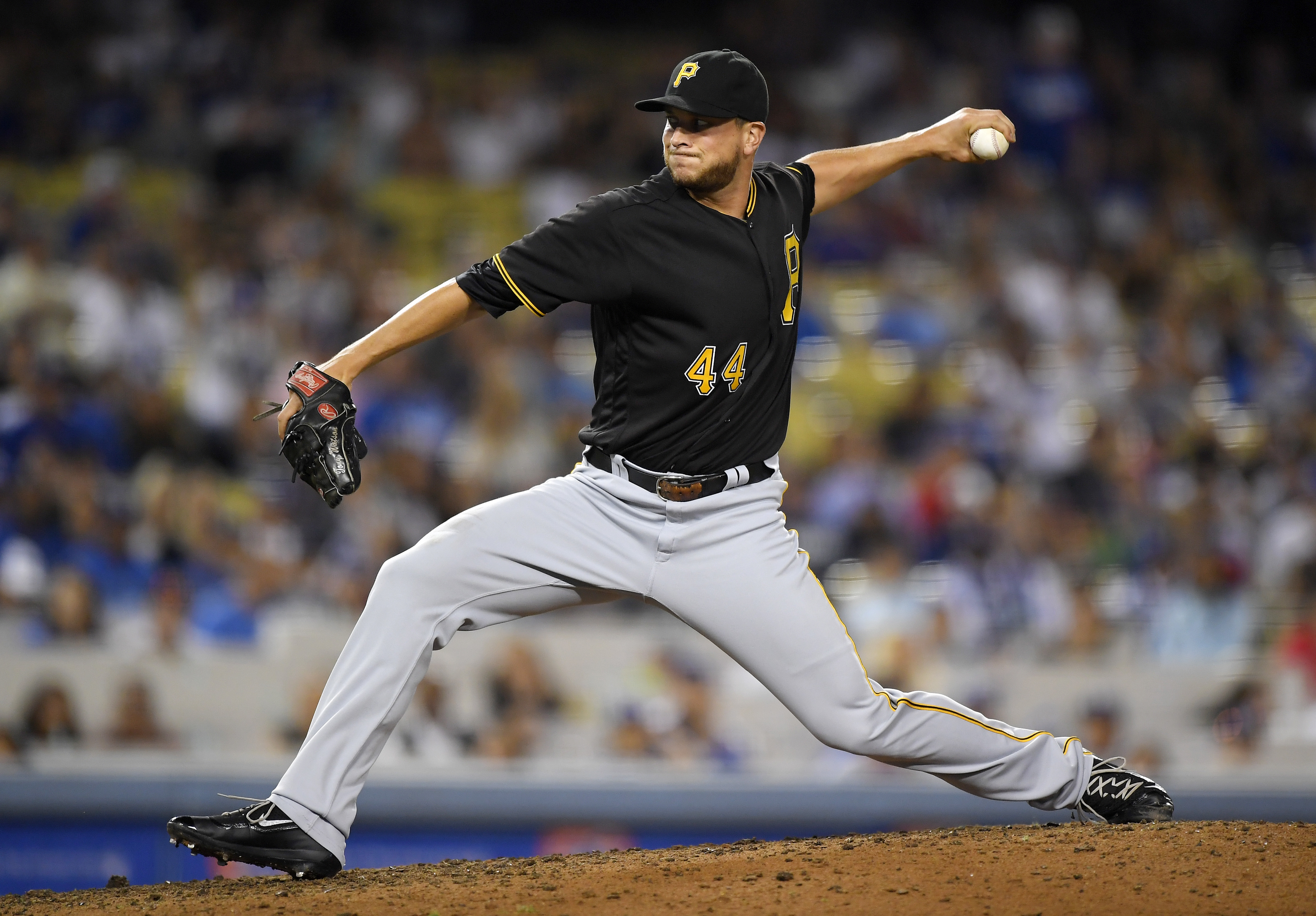 Pittsburgh Pirates relief pitcher Tony Watson throws during the ninth inning of a baseball game against the Los Angeles Dodgers, Friday, Aug. 12, 2016, in Los Angeles. The Pirates won 5-1. (AP Photo/Mark J. Terrill)