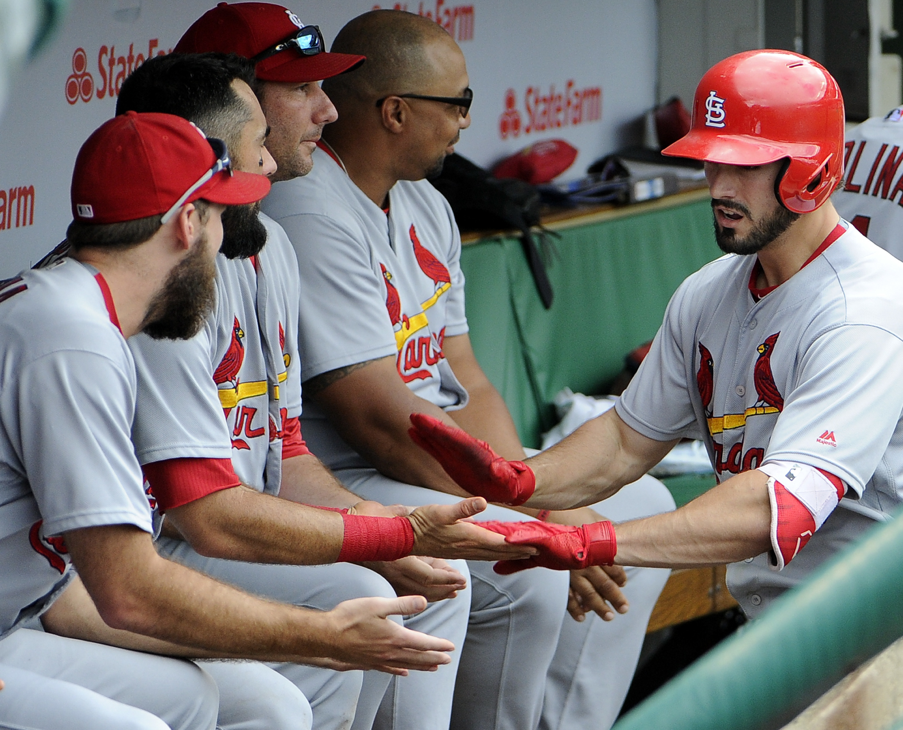St. Louis Cardinals' Randal Grichuk, right, is greeted by his teammates after hitting a grand slam against the Chicago Cubs during the eighth inning of a baseball game, Saturday, Aug. 13, 2016, in Chicago. (AP Photo/David Banks)