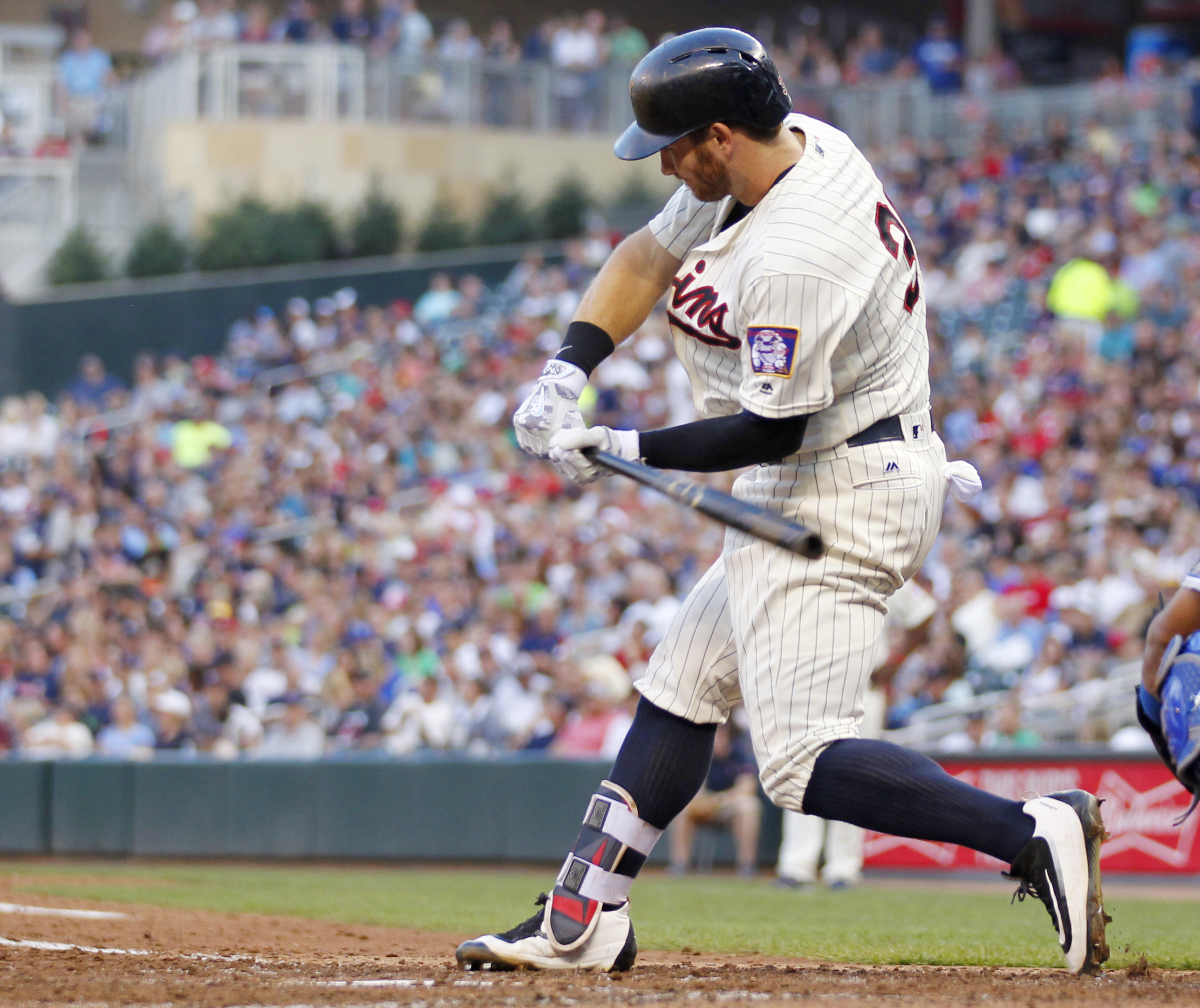 Minnesota Twins' Robbie Grossman swings into a home run against the Kansas City Royals in the fifth inning during a baseball game on Saturday, Aug., 13, 2016, in Minneapolis.(AP Photo/Andy Clayton-King)