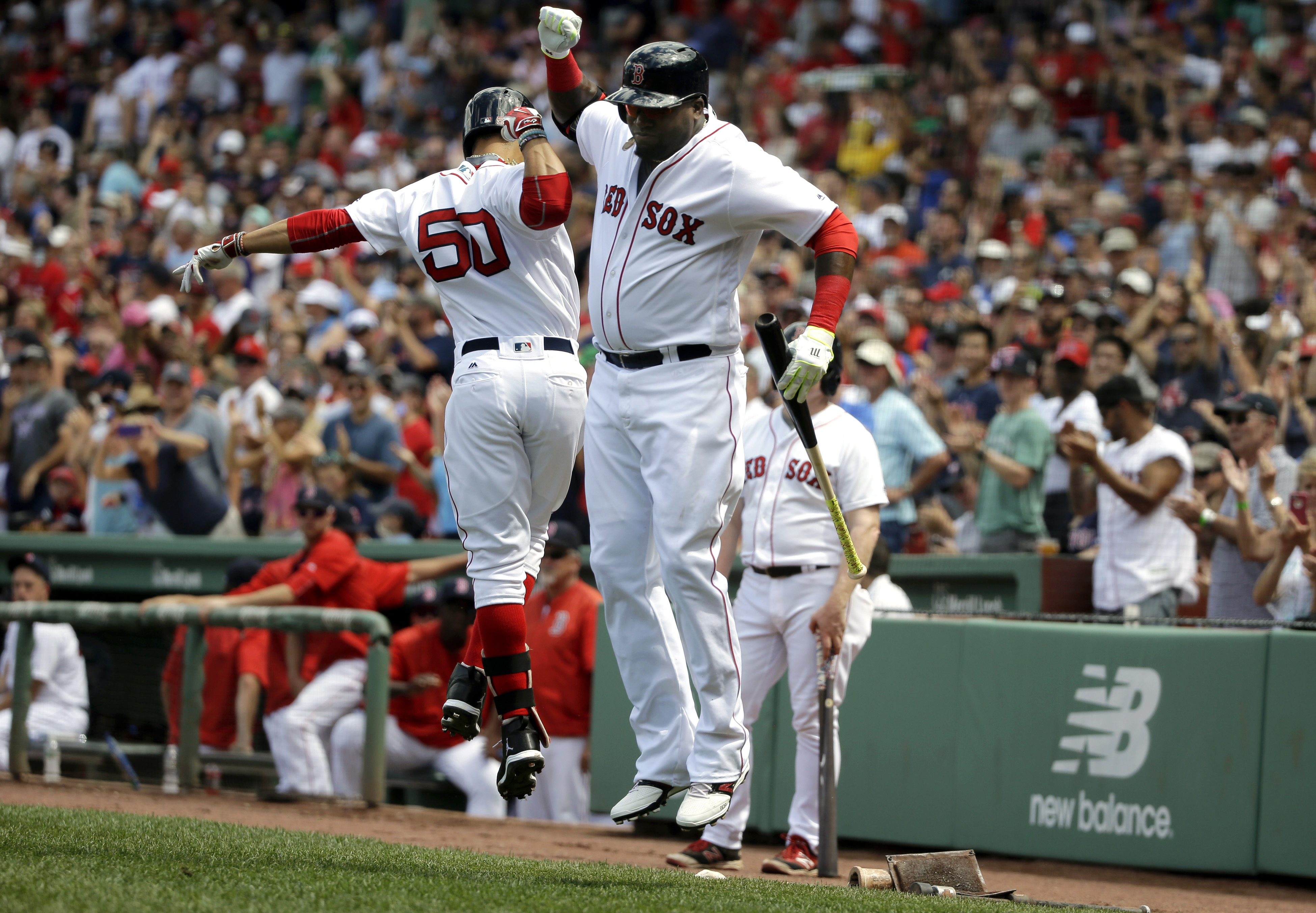 Boston Red Sox's Mookie Betts (50), left, celebrates with teammate David Ortiz, right, after hitting a two-run home run off a pitch from Arizona Diamondbacks starting pitcher Zack Greinke in the first inning of a baseball game, Sunday, Aug. 14, 2016, in B