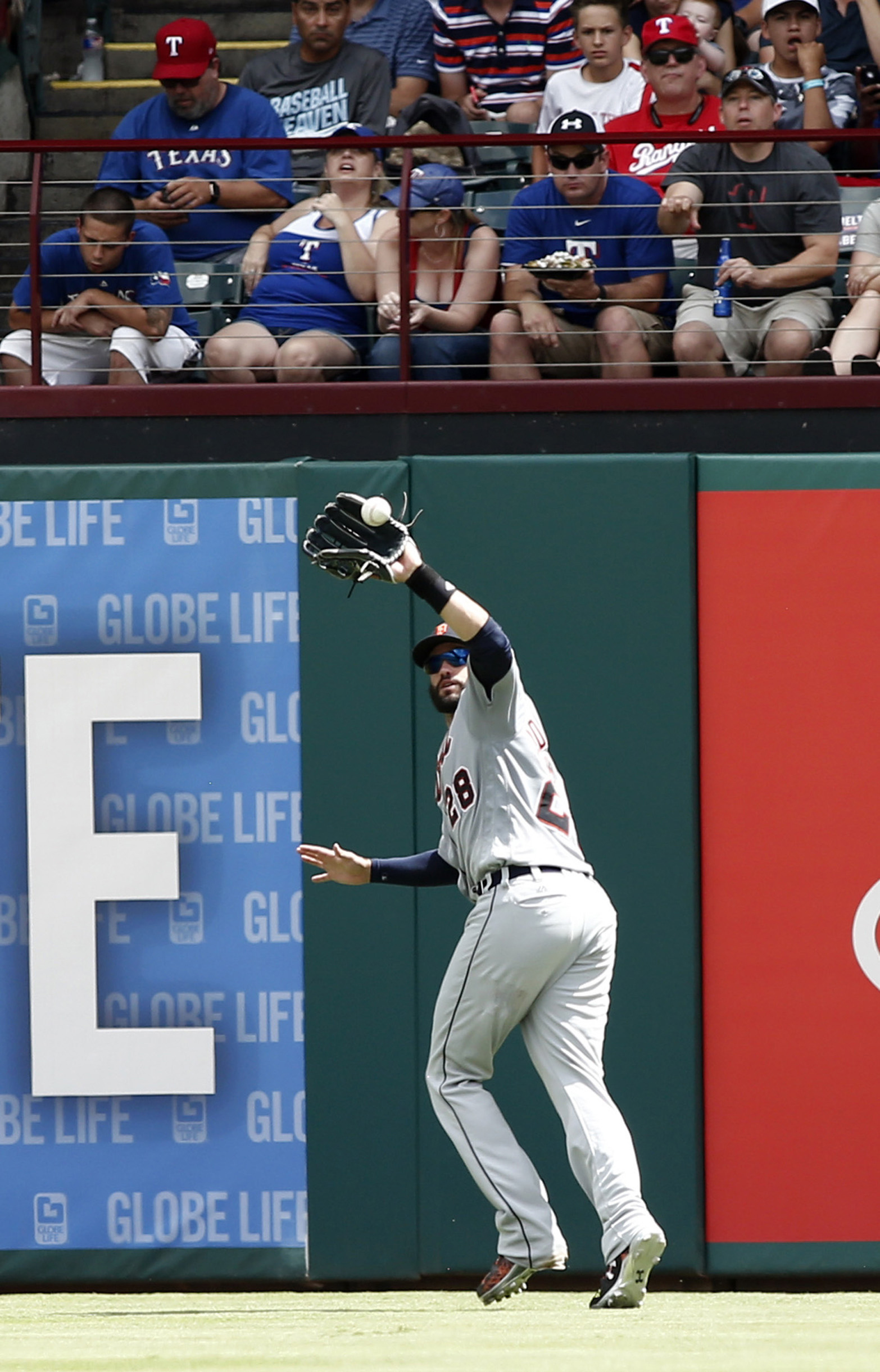Detroit Tigers right fielder J.D. Martinez makes the catch for the out on a line drive by Texas Rangers' Jurickson Profar during the fifth inning of a baseball game Sunday, Aug. 14, 2016, in Arlington, Texas. (AP Photo/Mike Stone)