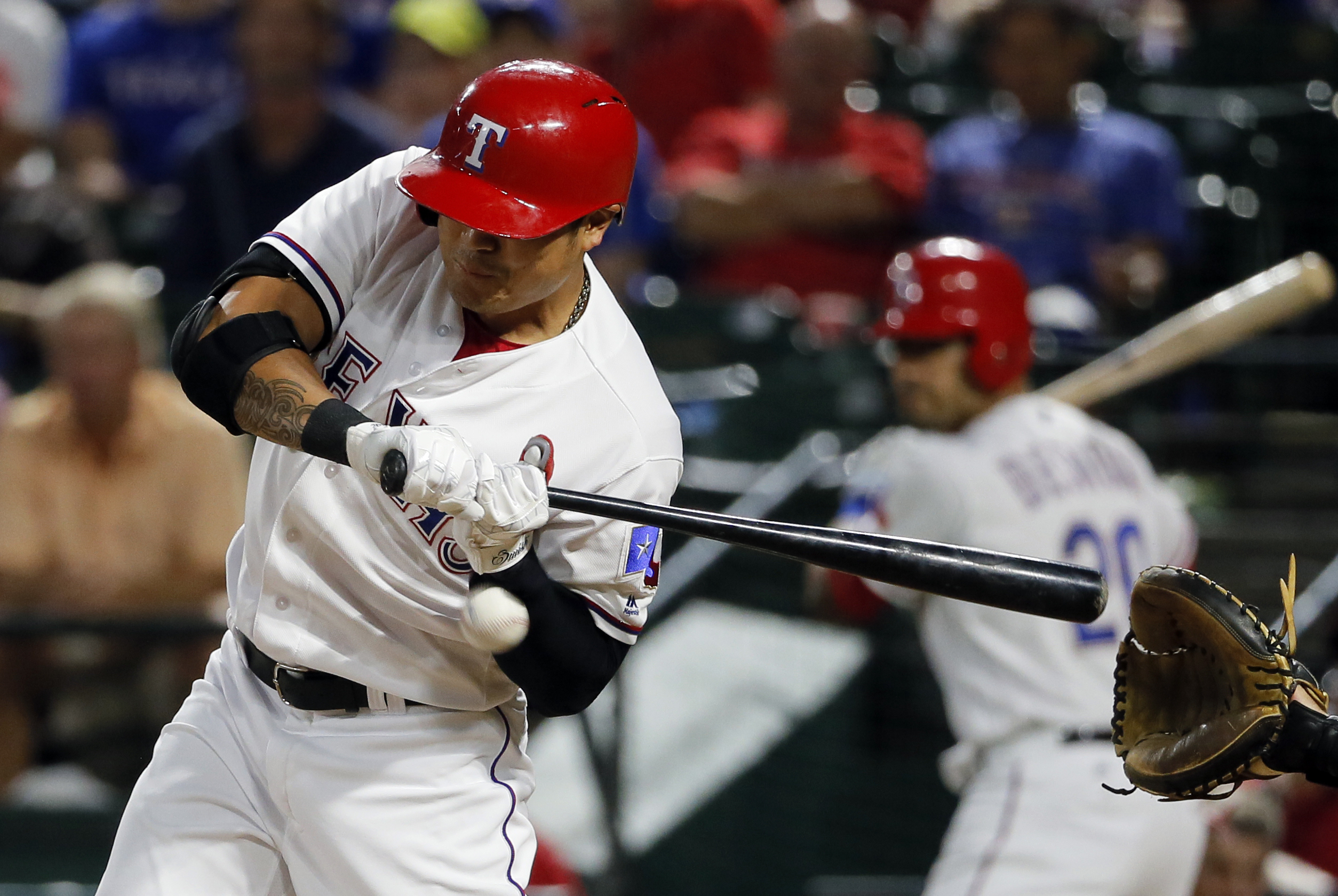 Texas Rangers' Shin-Soo Choo, of South Korea, is hit in the left wrist by a pitch from Oakland Athletics starting pitcher Ross Detwiler in the fifth inning of a baseball game, Monday, Aug. 15, 2016, in Arlington, Texas. (AP Photo/Tony Gutierrez)