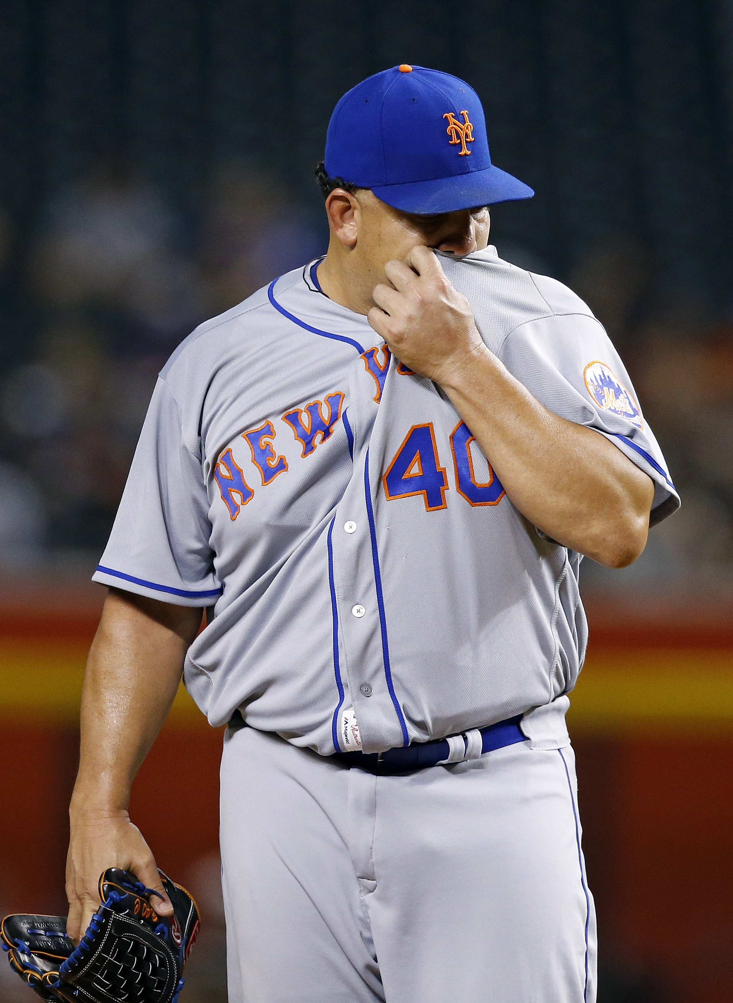 New York Mets' Bartolo Colon pauses on the mound on his way to giving up three run against the Arizona Diamondbacks during the first inning of a baseball game, Monday, Aug. 15, 2016, in Phoenix. (AP Photo/Ross D. Franklin)