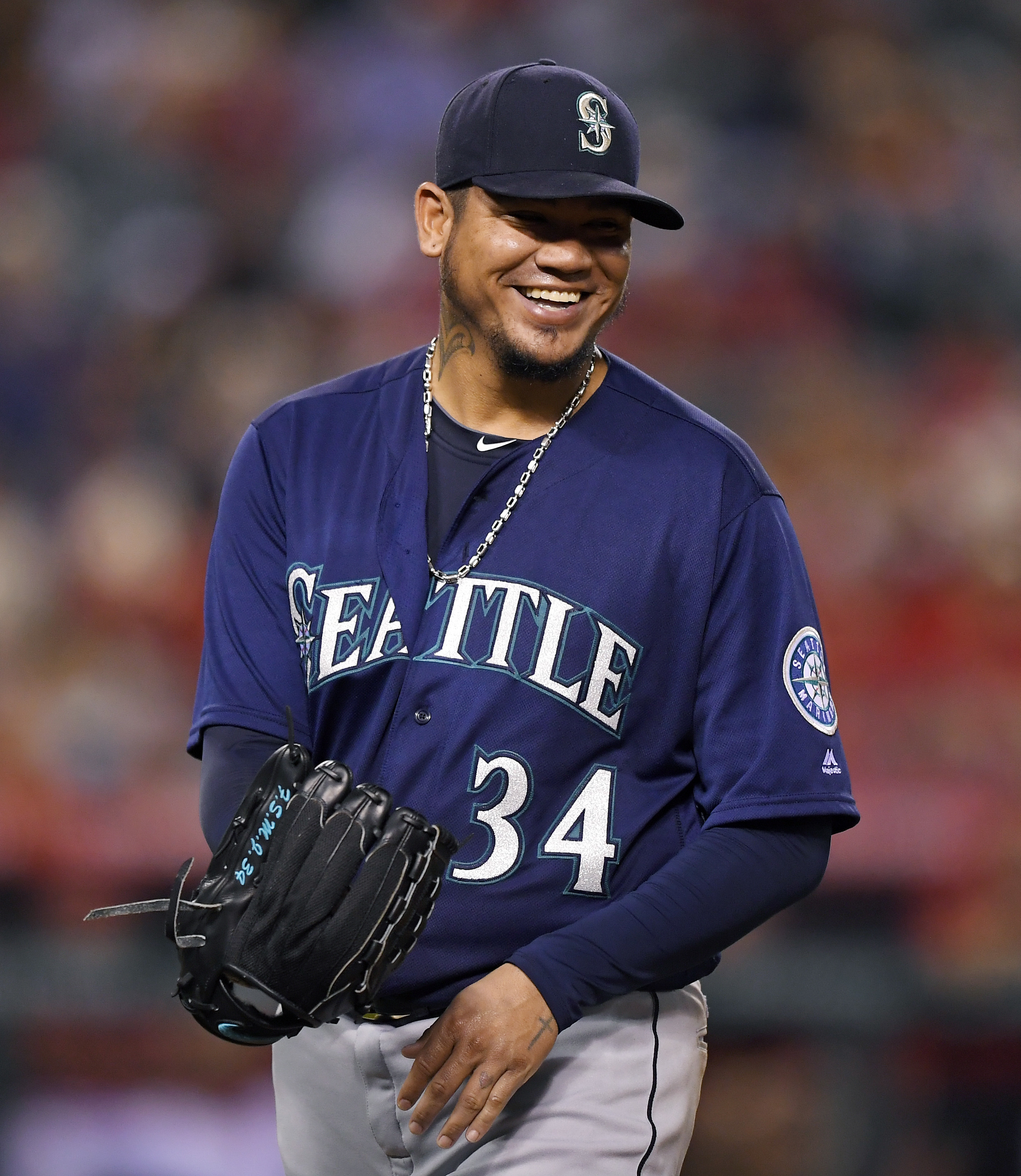 Seattle Mariners starting pitcher Felix Hernandez smiles after being taken out of the game in the seventh inning of a baseball game against the Los Angeles Angels, Monday, Aug. 15, 2016, in Anaheim, Calif. (AP Photo/Mark J. Terrill)