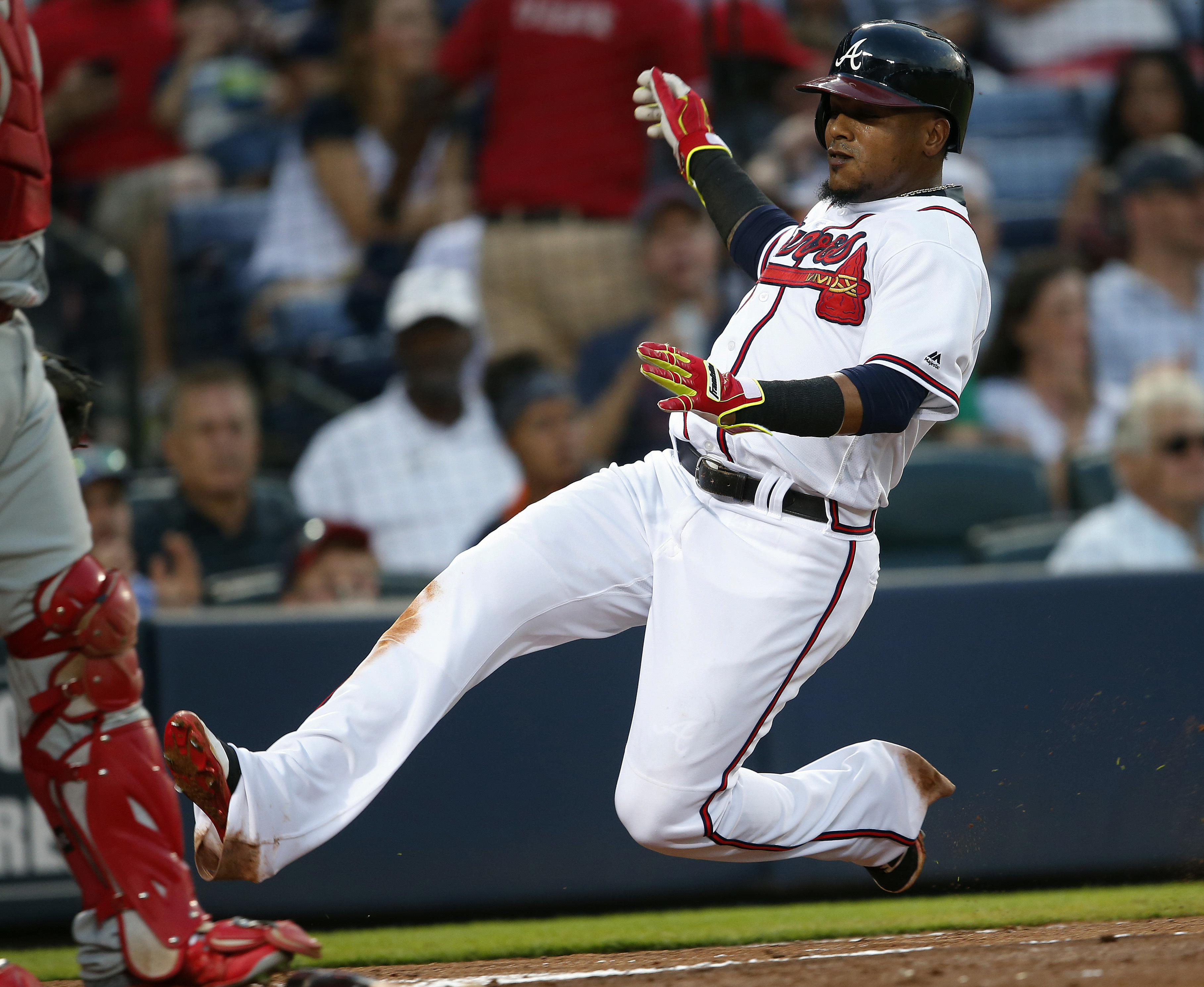 FILE - In this July 29, 2016, file photo, Atlanta Braves' Erick Aybar scores against the Philadelphia Phillies in a baseball game in Atlanta .Aybar has been traded to the Detroit Tigers for minor league catcher Kade Scivicque. Aybar gives the Tigers exper