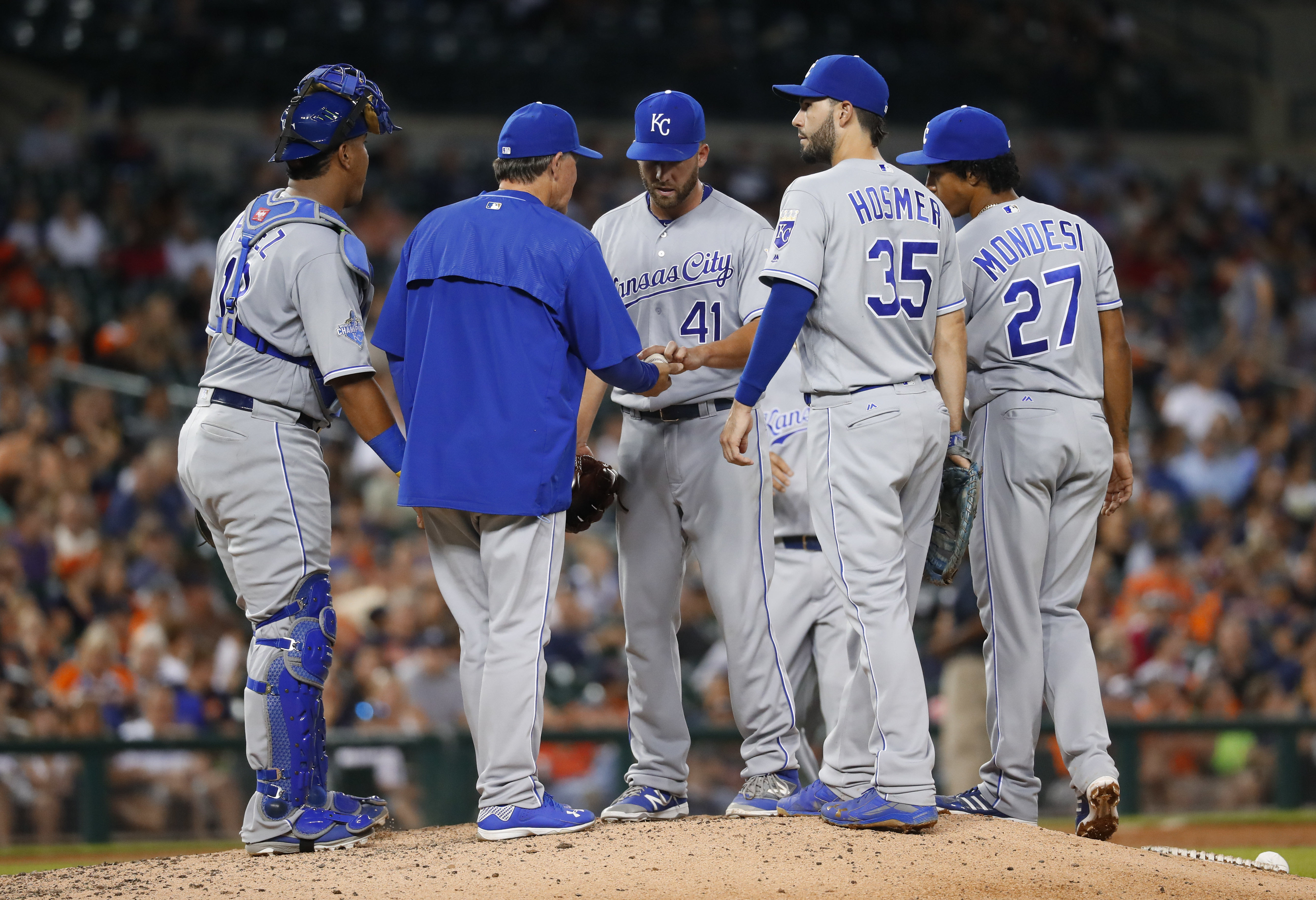 Kansas City Royals manager Ned Yost takes the ball from pitcher Danny Duffy in the eighth inning of a baseball game against the Detroit Tigers in Detroit, Tuesday, Aug. 16, 2016. (AP Photo/Paul Sancya)