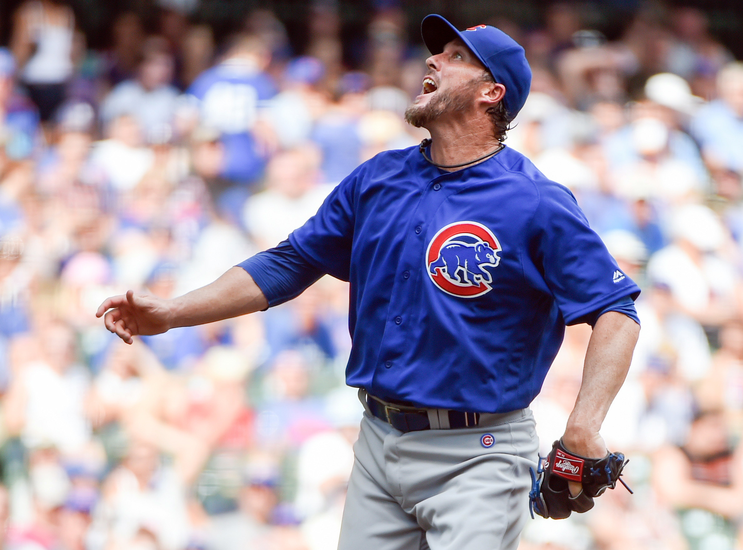 FILE - This July 24, 2016 file photo shows Chicago Cubs pitcher Joe Nathan reacting after a throw during the sixth inning of a baseball game against the Milwaukee Brewers in Milwaukee. The Giants and Nathan agreed Tuesday, Aug. 16, 2016 to a minor league