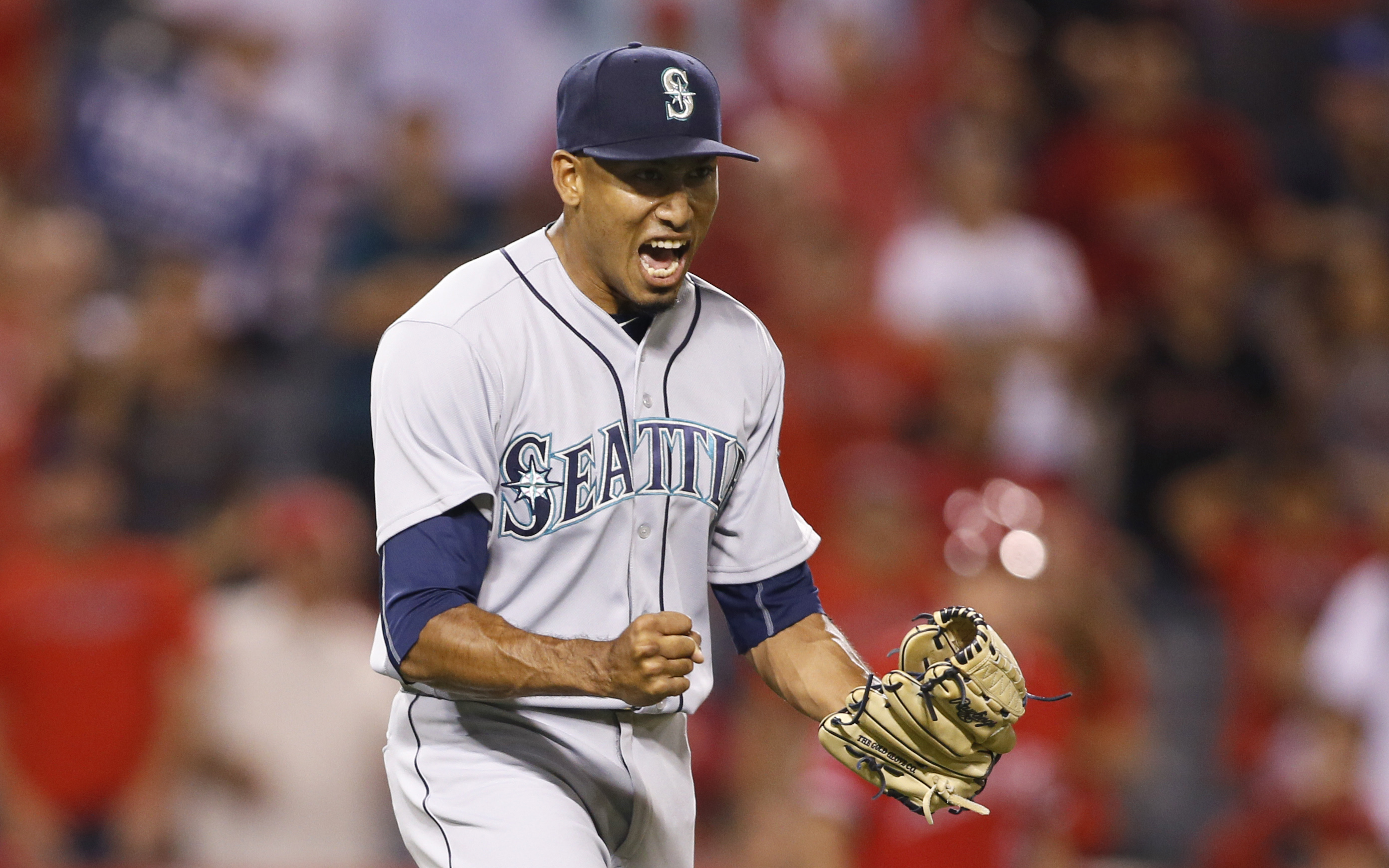Seattle Mariners Edwin Diaz celebrates after third baseman Kyle Seager dove to stop a ball and throw out Los Angeles Angels' Andrelton Simmons at first base to end the game and give the Mariners a 4-3 victory in the bottom of the ninth inning of a basebal
