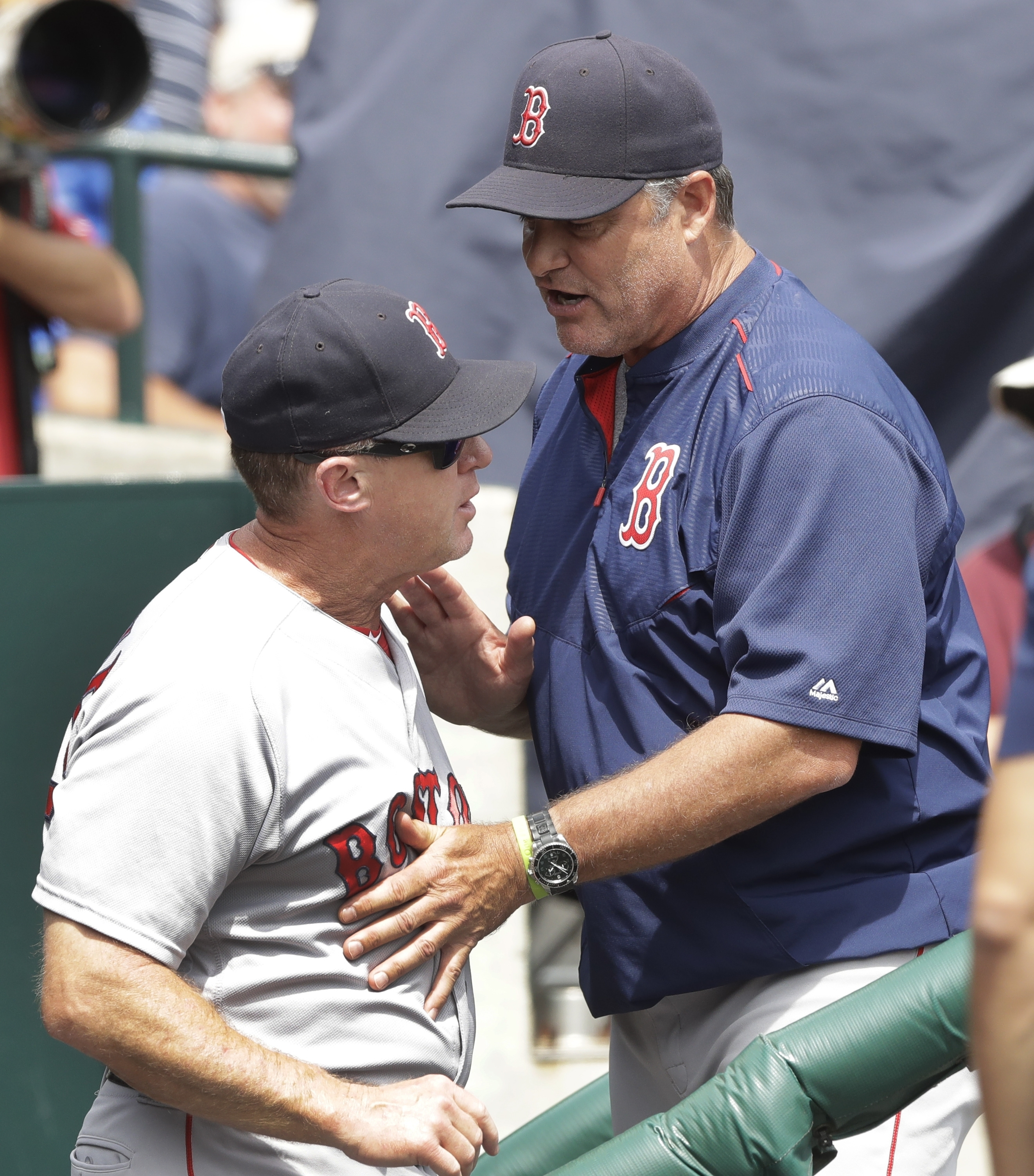 Boston Red Sox manager John Farrell, right, holds back third base coach Brian Butterfield in the dugout after Butterfield was ejected during the second inning of a baseball game against the Detroit Tigers, Thursday, Aug. 18, 2016, in Detroit. (AP Photo/Ca