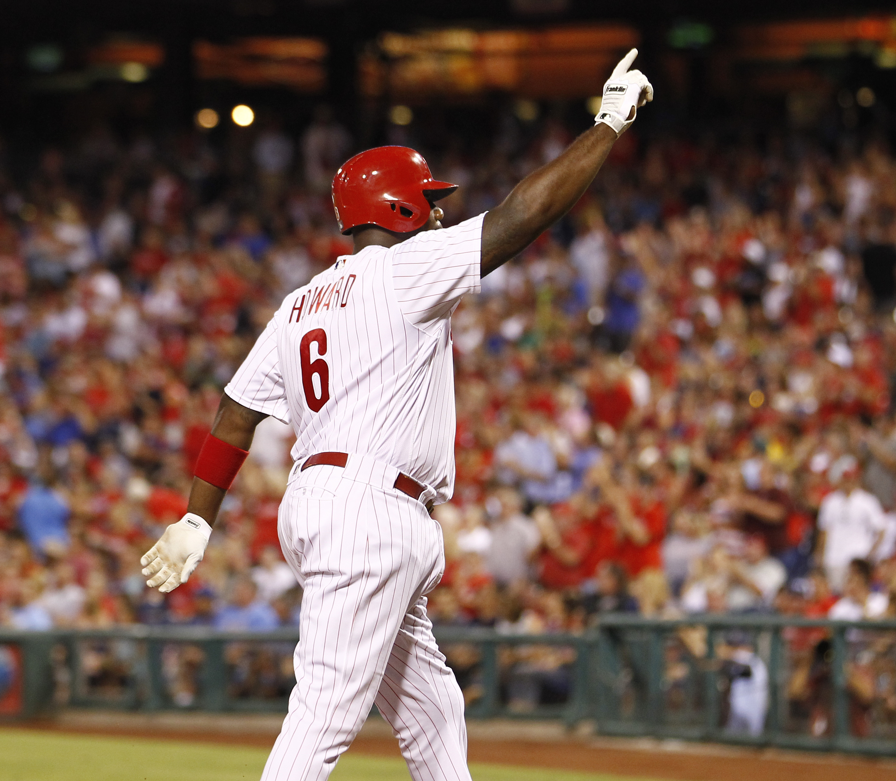 Philadelphia Phillies' Ryan Howard acknowledges fans after hitting a solo home run during the fourth inning of a baseball game against the Los Angeles Dodgers, Thursday, Aug. 18, 2016, in Philadelphia. (AP Photo/Tom Mihalek)
