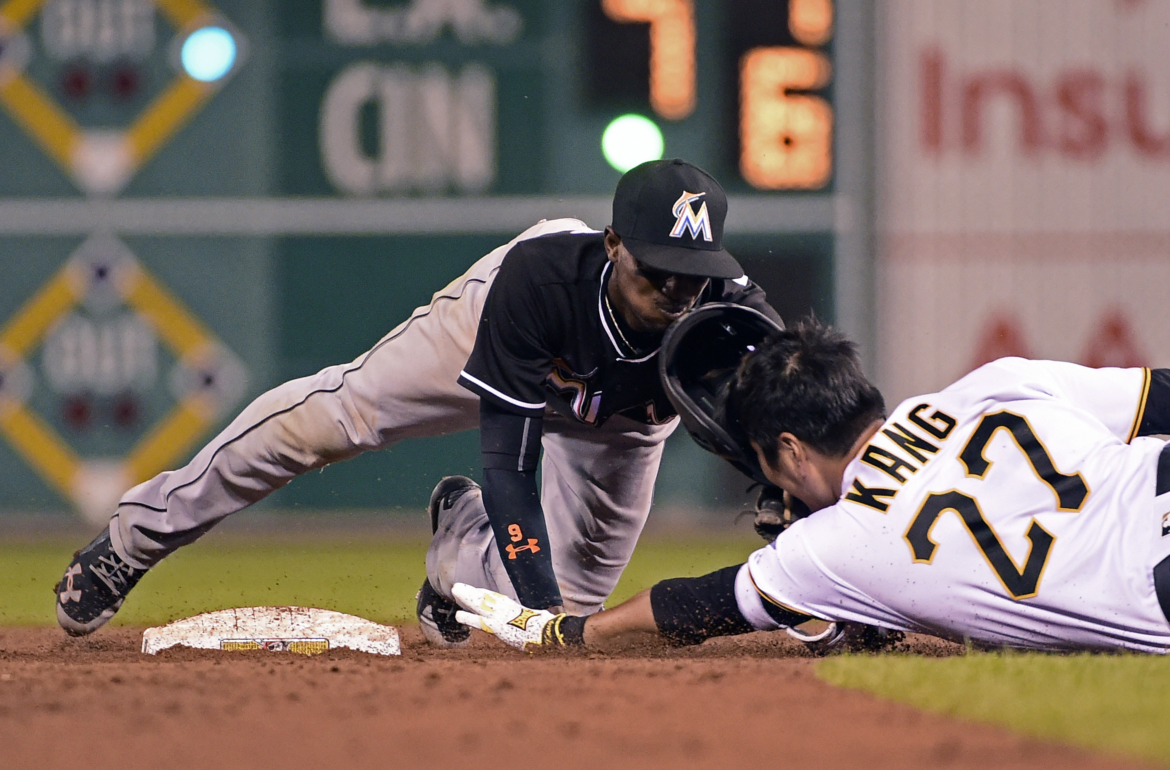 Miami Marlins' Dee Gordon tags out Pittsburgh Pirates' Jung Ho Kang in the eighth inning of a baseball game against in Pittsburgh, Friday, Aug. 19, 2016. (AP Photo/Fred Vuich)