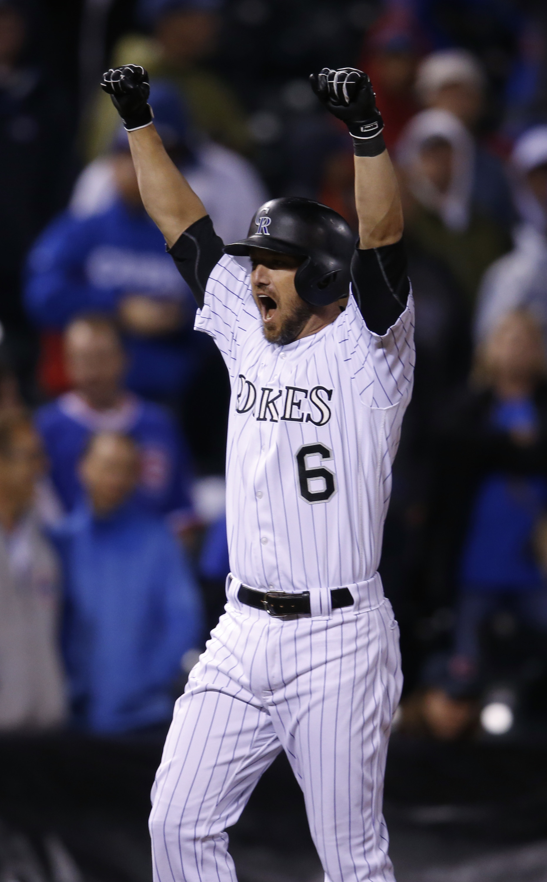 Colorado Rockies' Ryan Raburn reacts as he is ordered in to score the winning run by umpires in the 11th inning of a baseball game against the Chicago Cubs early on Saturday, Aug. 20, 2016 in Denver. The Rockies won 7-6 when Raburn, who had just hit an RB