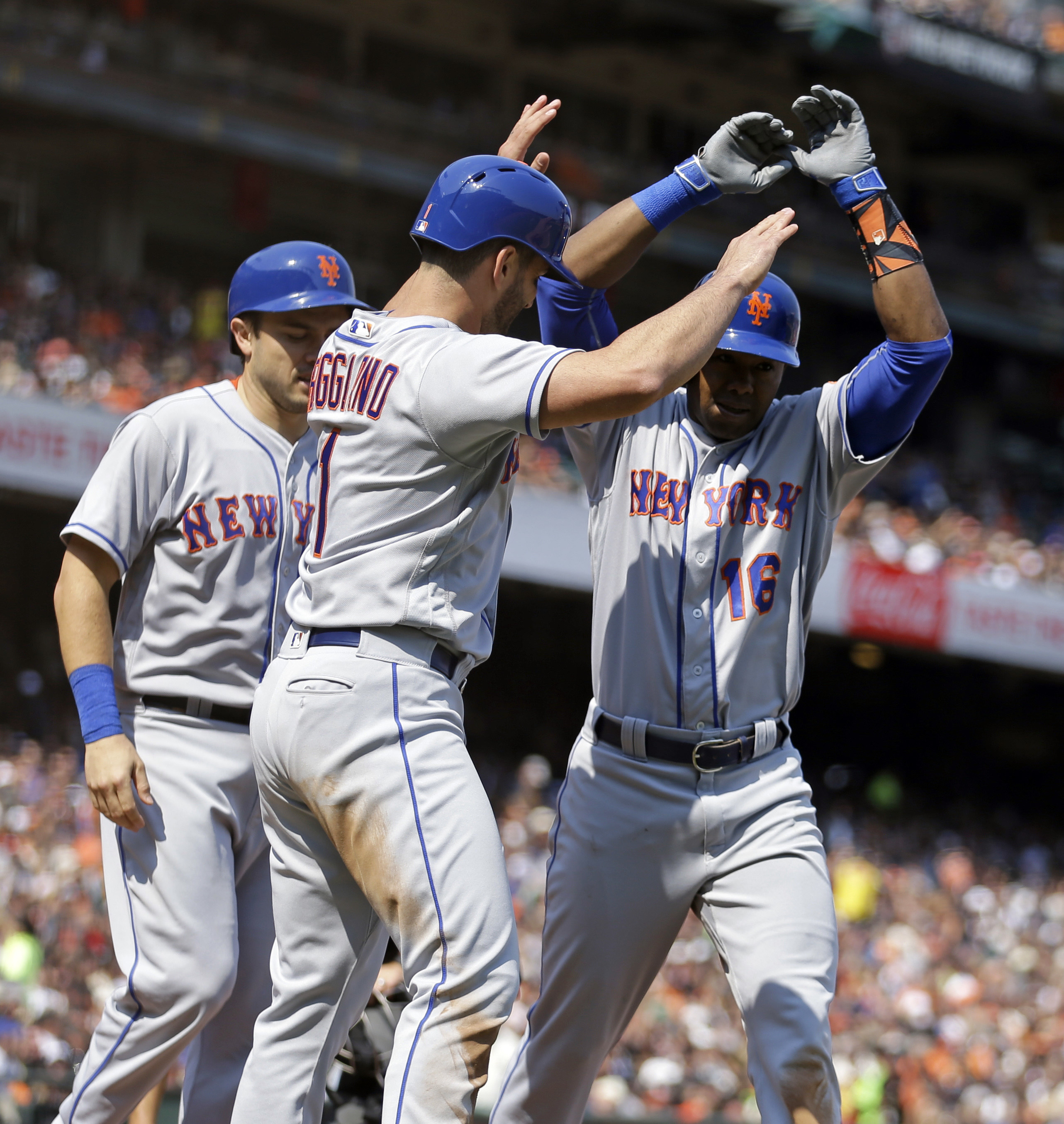 New York Mets' Alejandro De Aza, right, celebrates with Travis d'Arnaud, left, and Justin Ruggiano (1) after hitting a three-run home run off San Francisco Giants' Jake Peavy in the sixth inning of a baseball game Saturday, Aug. 20, 2016, in San Francisco