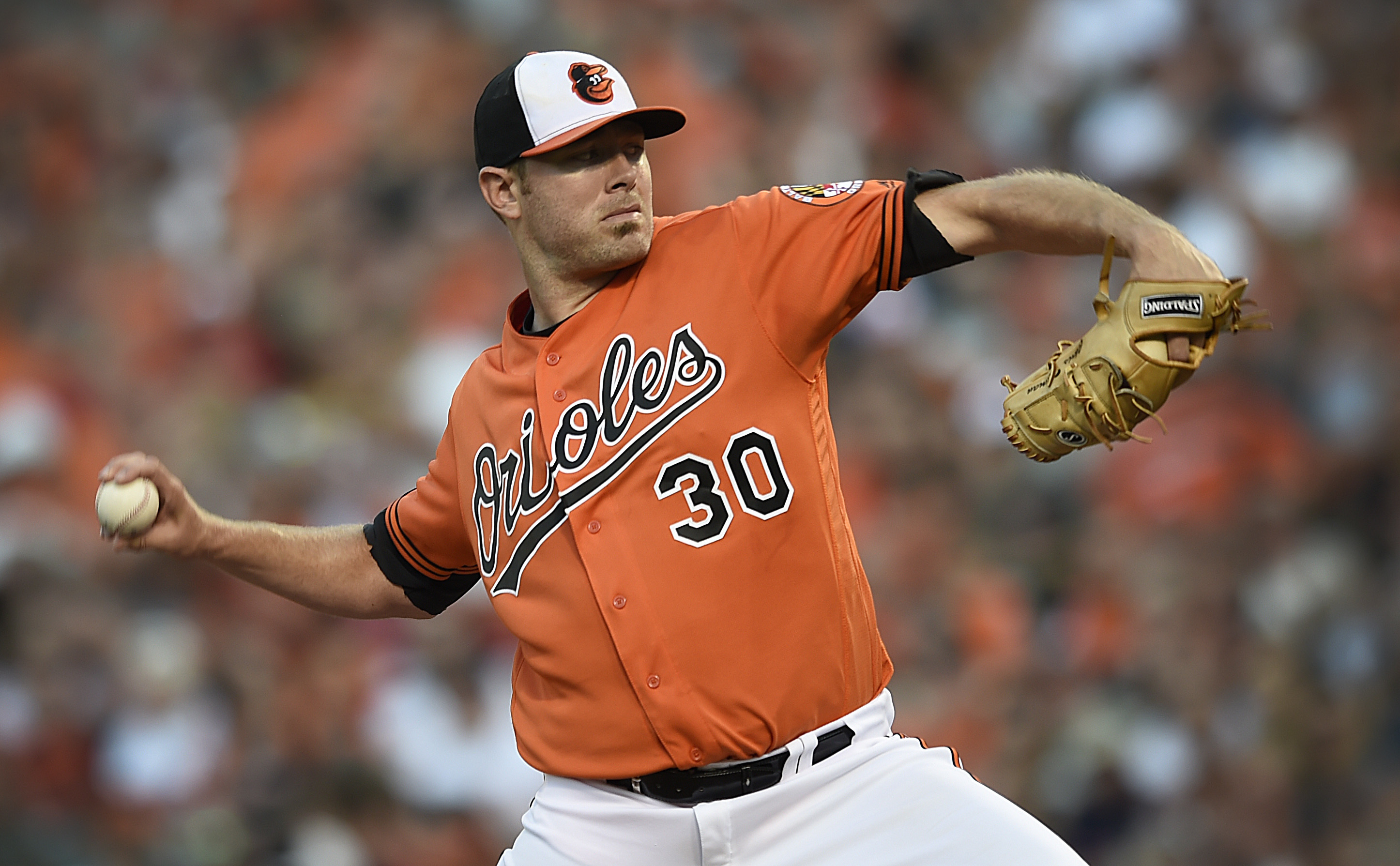 Baltimore Orioles pitcher Chris Tillman delivers against the Houston Astros in the first inning of a baseball game, Saturday, Aug. 20, 2016, in Baltimore. (AP Photo/Gail Burton)