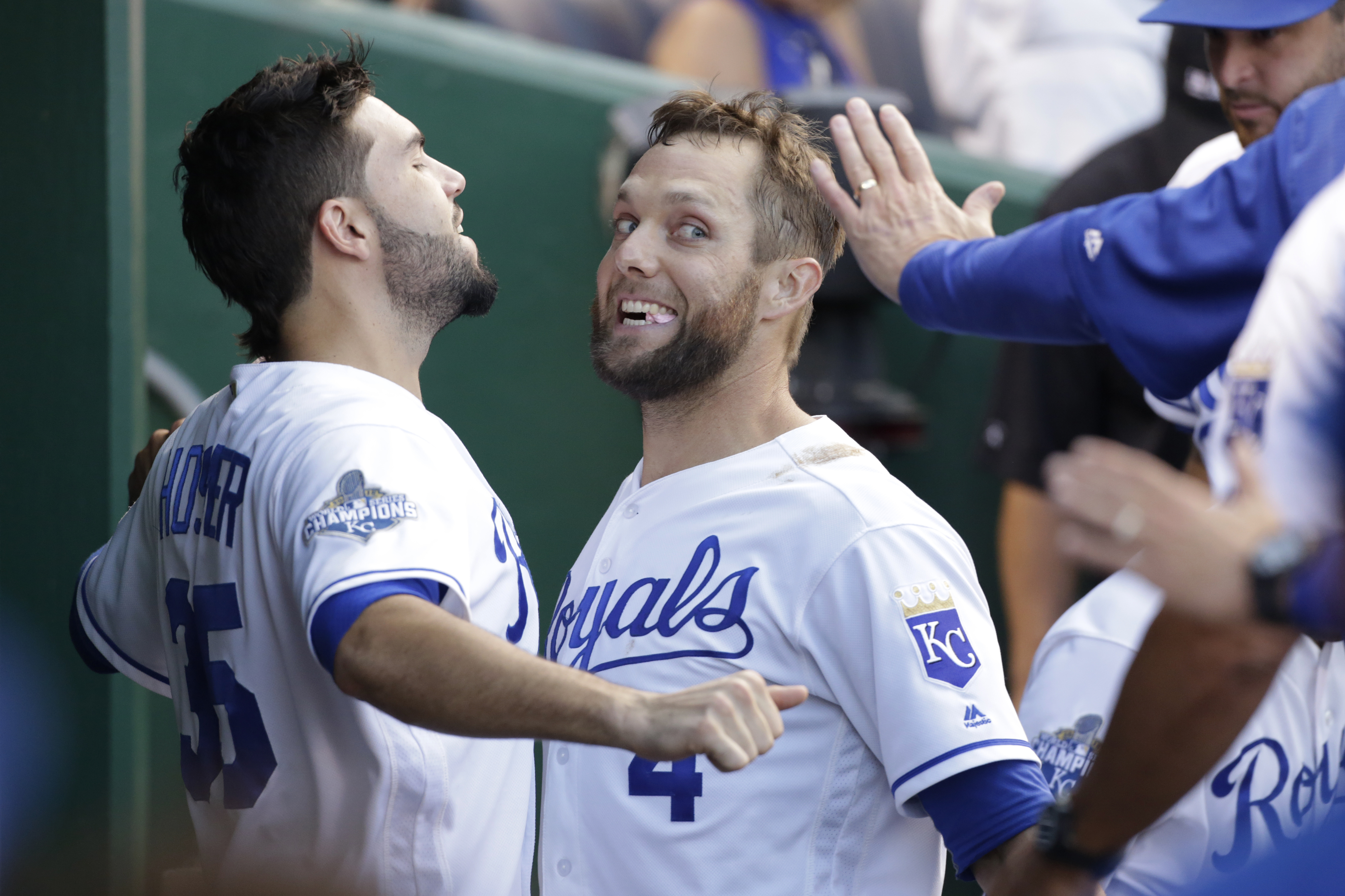 Kansas City Royals' Alex Gordon (4) reacts as he celebrates with Eric Hosmer (35) in the dugout after hitting a home run in the 4th inning of a baseball game against the at Kauffman Stadium in Kansas City, Mo., Saturday, Aug. 20, 2016. (AP Photo/Colin E.