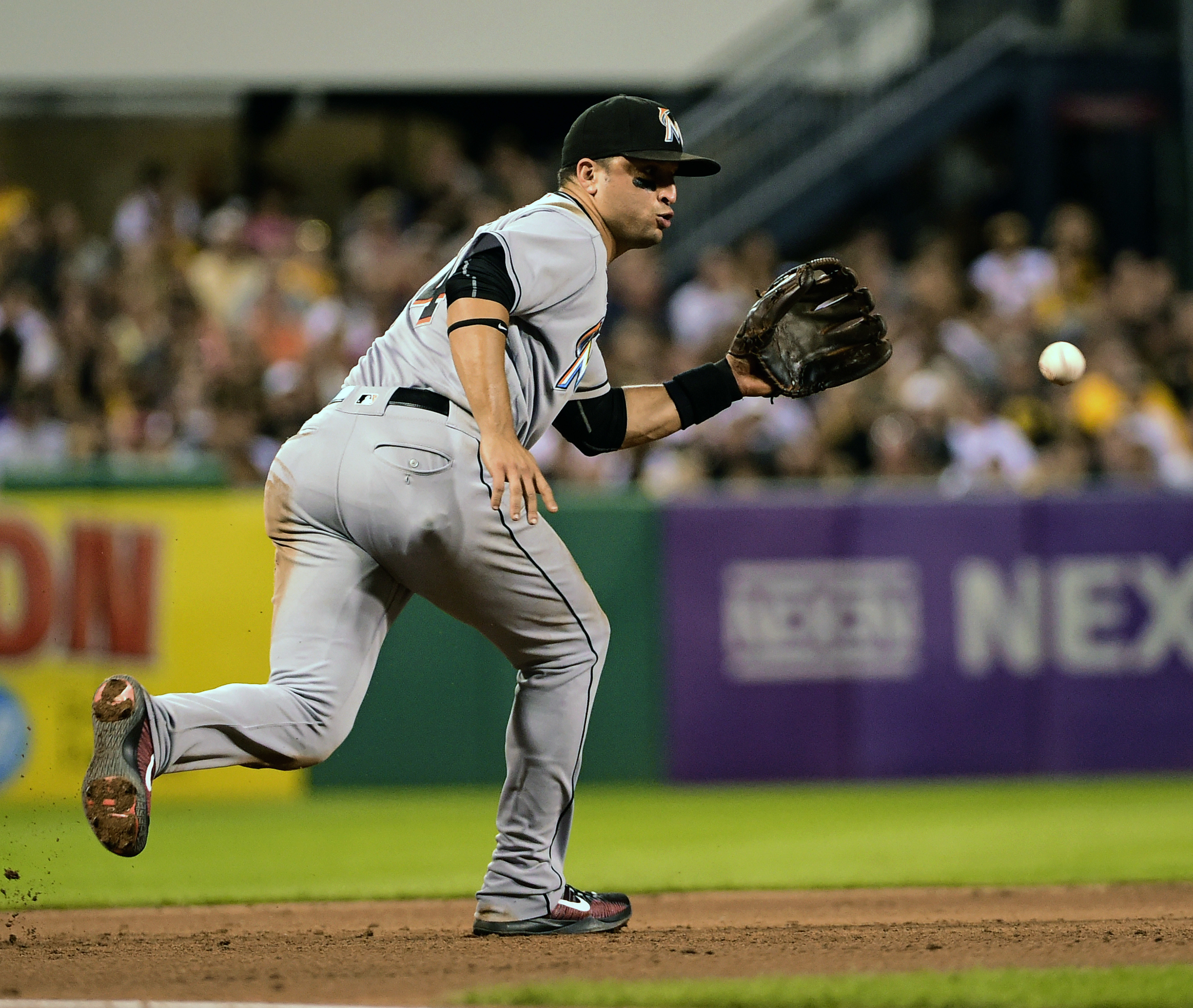 Miami Marlins' Martin Prado fields a ball hit by Pittsburgh Pirates' Starling Marte during the eighth inning of a baseball game in Pittsburgh, Saturday, Aug. 20, 2016. Prado threw to second for a force on Josh Harrison to end the inning. (AP Photo/Fred Vu