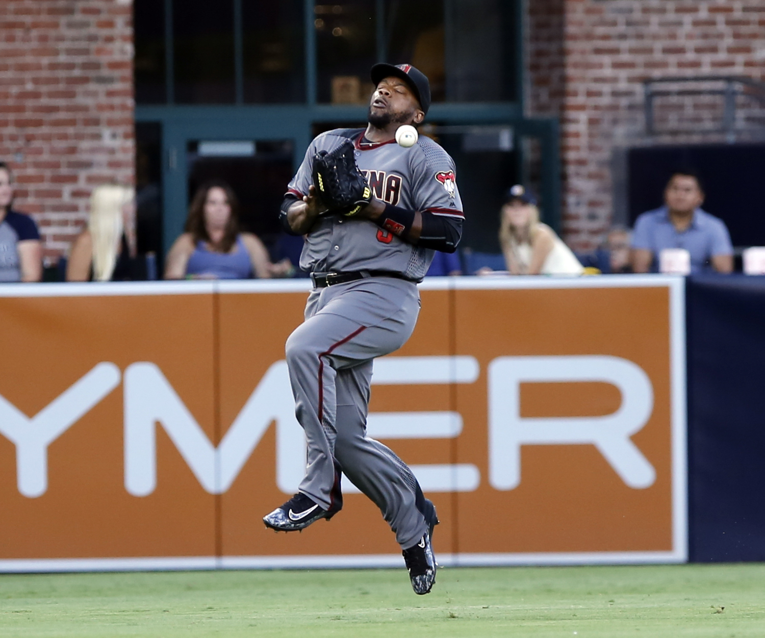 Arizona Diamondbacks left fielder Ricky Weeks Jr. bobbles this pop fly by San Diego Padres' Ryan Schimpf during the fourth inning in a baseball game, Saturday, Aug. 20, 2016, in San Diego. Schimpf was safe on the fielding error. (AP Photo/Don Boomer)