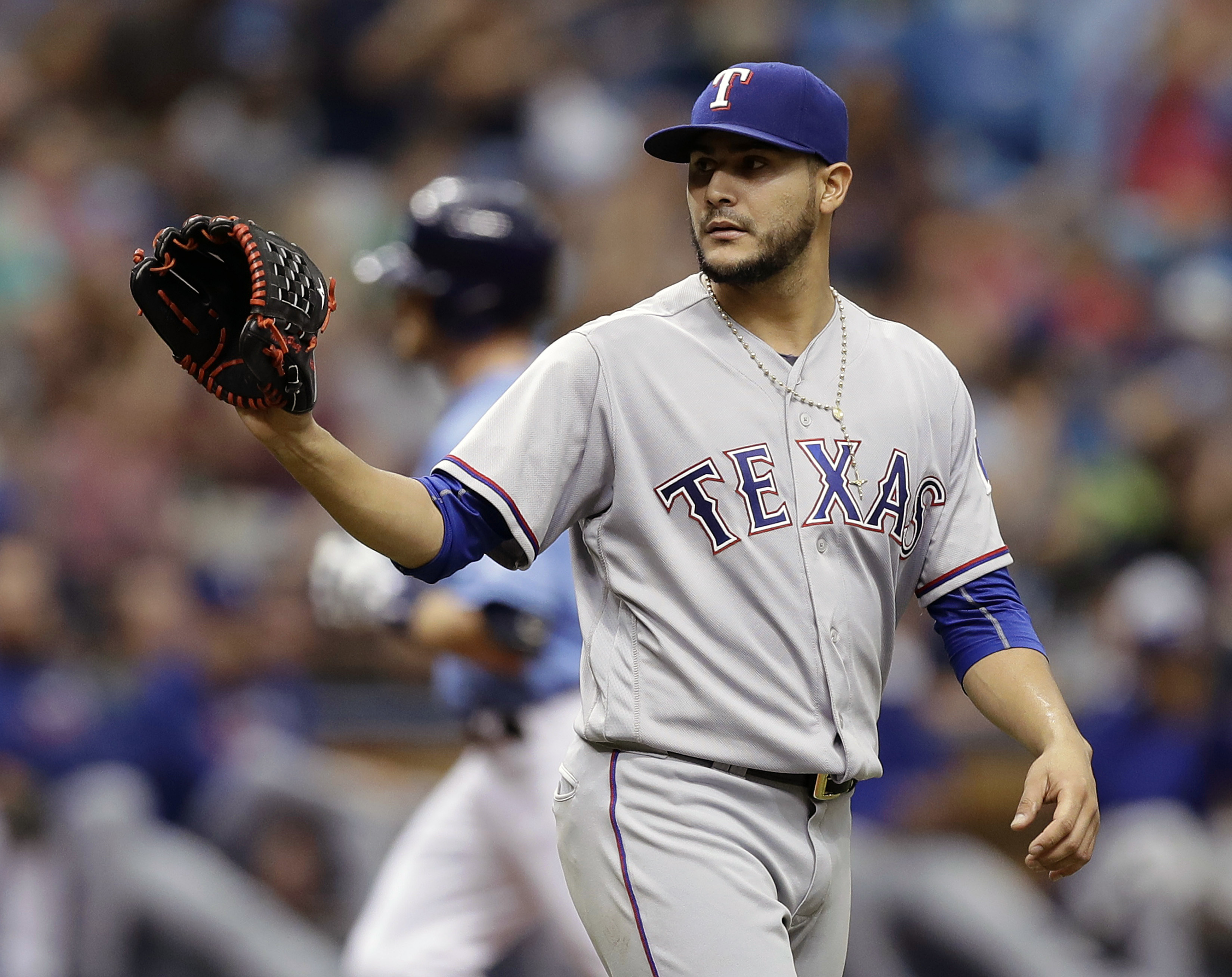 Texas Rangers starting pitcher Martin Perez waits for a new ball as Tampa Bay Rays' Logan Forsythe runs around the bases following a his three-run home run during the fourth inning of a baseball game Sunday, Aug. 21, 2016, in St. Petersburg, Fla. (AP Phot