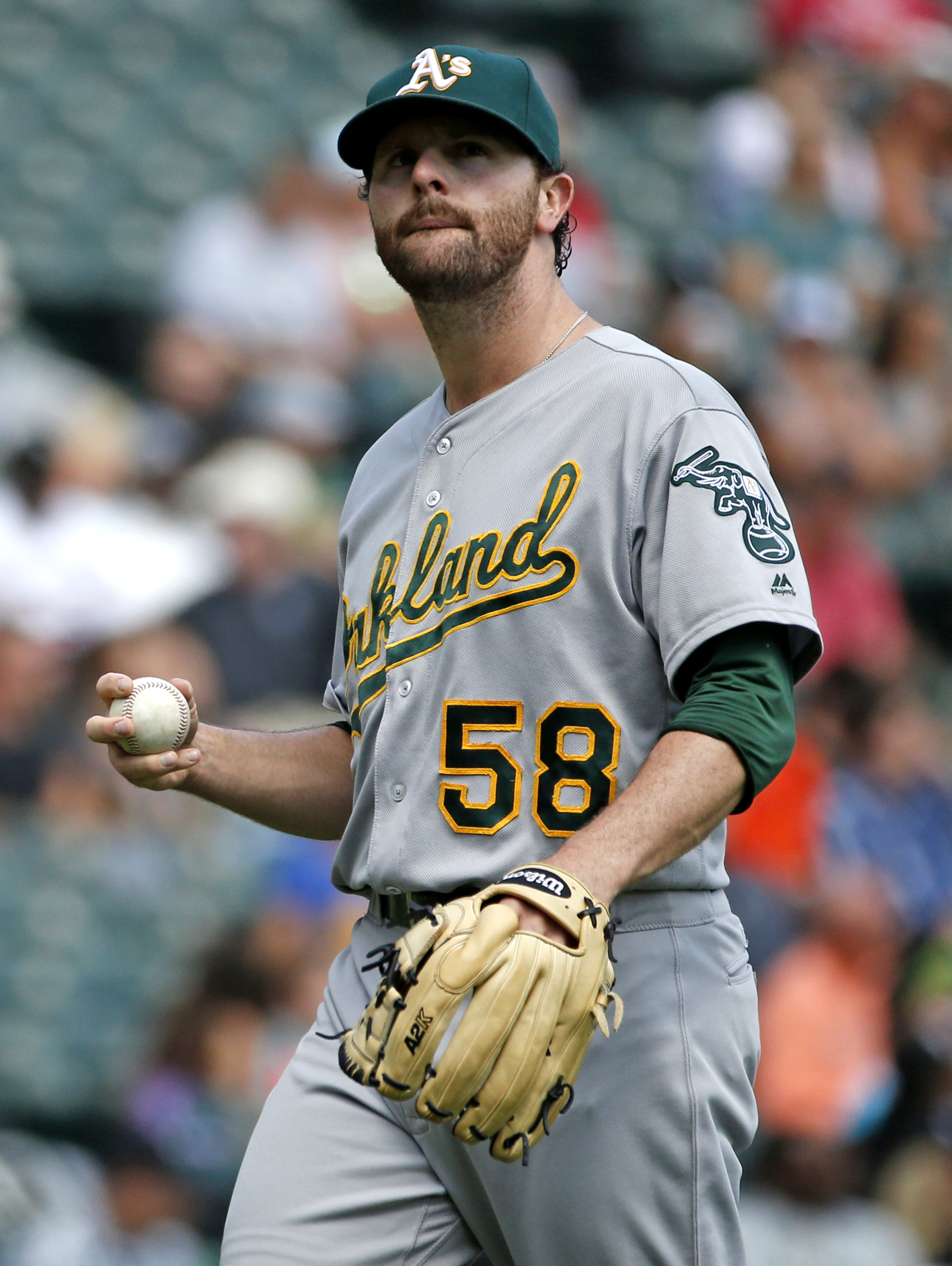 Oakland Athletics starter Zach Neal reacts during the fourth inning of a baseball game against the Chicago White Sox in Chicago, Sunday, Aug. 21, 2016. (AP Photo/Nam Y. Huh)