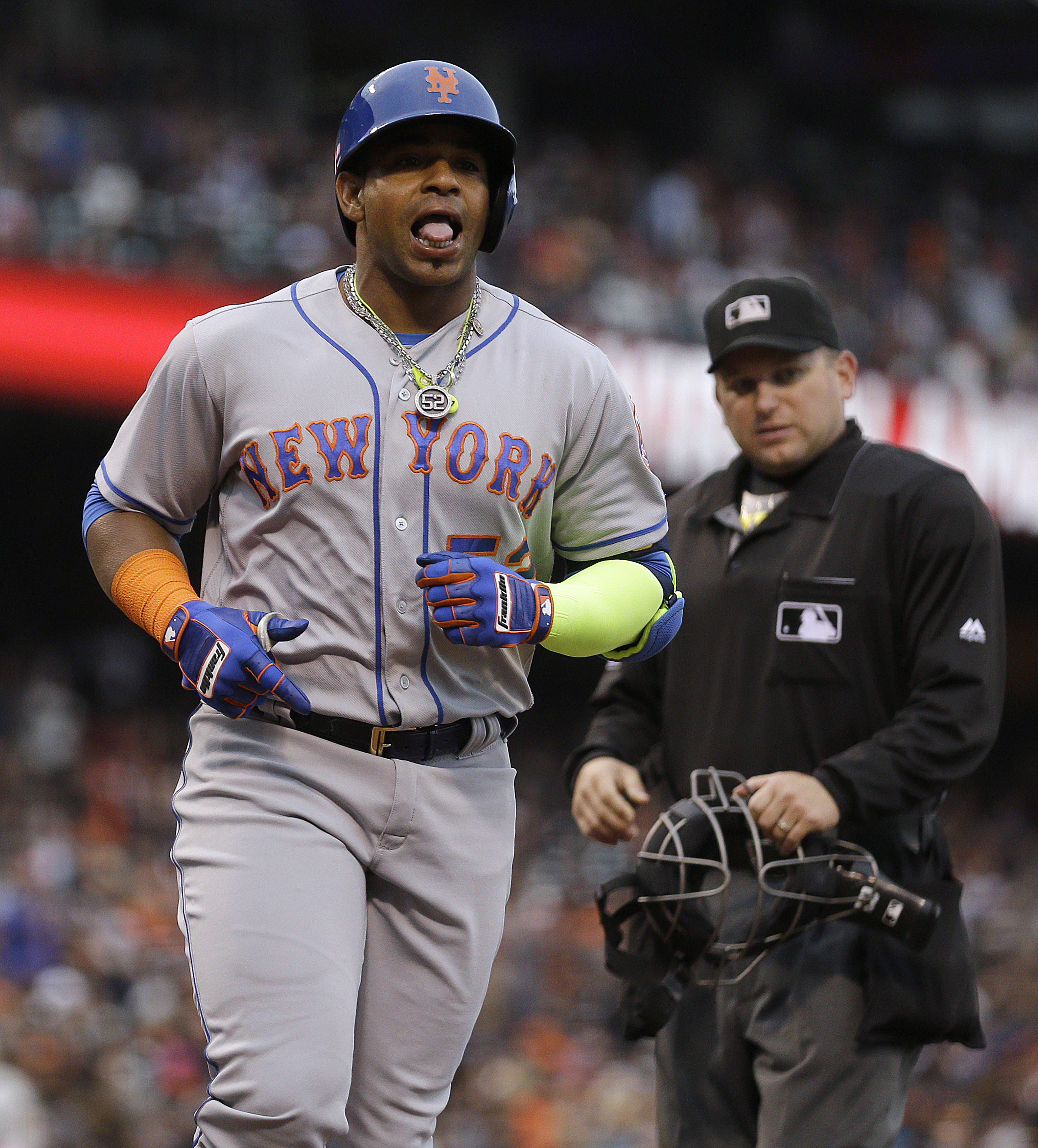 Home plate umpire Clint Fagan, right, watches as New York Mets' Yoenis Cespedes celebrates after hitting a two run home run off San Francisco Giants' Jeff Samardzija in the seventh inning of a baseball game Sunday, Aug. 21, 2016, in San Francisco. (AP Pho