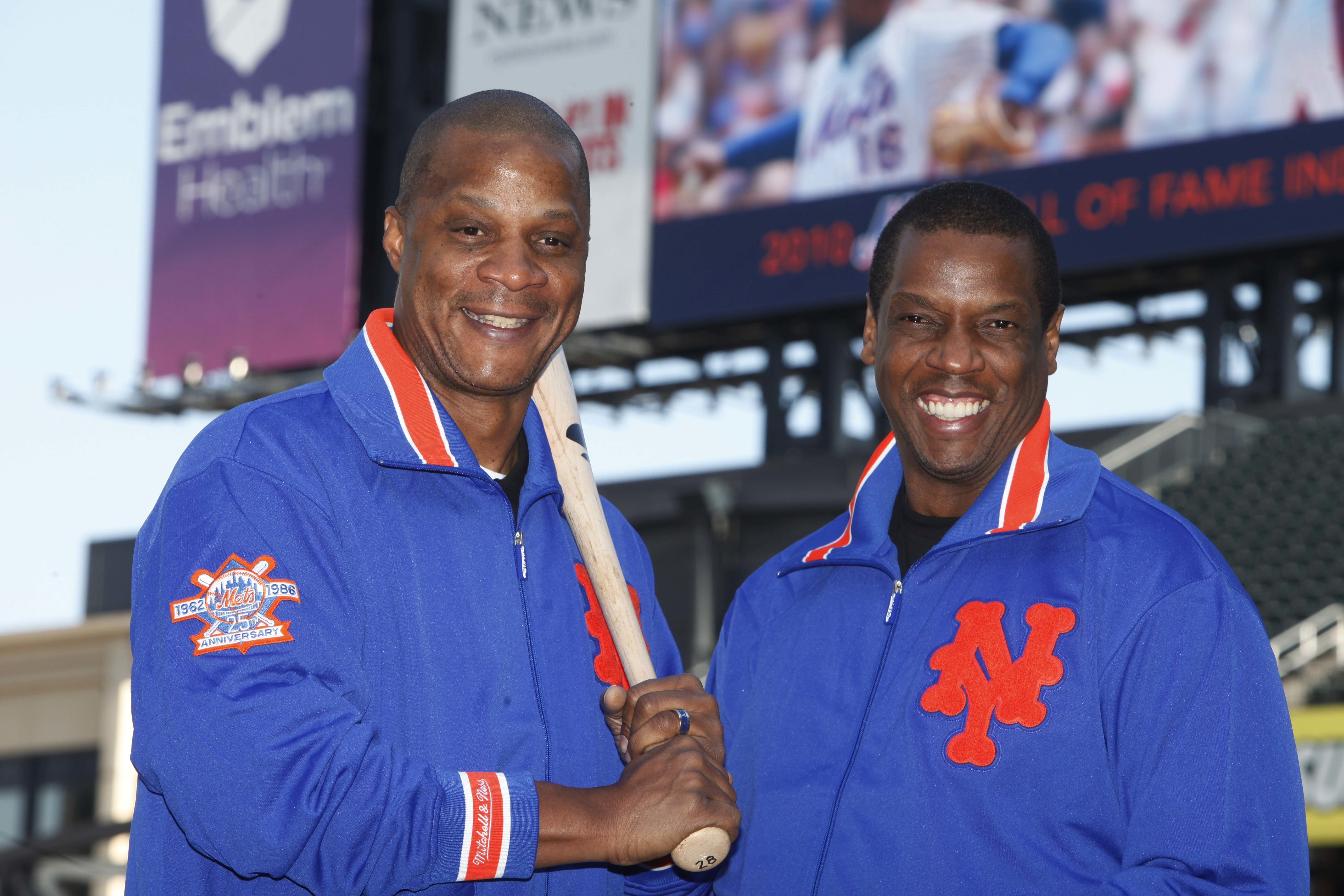 FILE - This Aug. 1, 2010, file photo shows former New York Mets' players Dwight Gooden, right, and Darryl Strawberry posing at Citi Field in New York. Gooden has denied, Monday, Aug. 22, 2016, Darryl Strawberrys accusation that he is a complete junkie-add