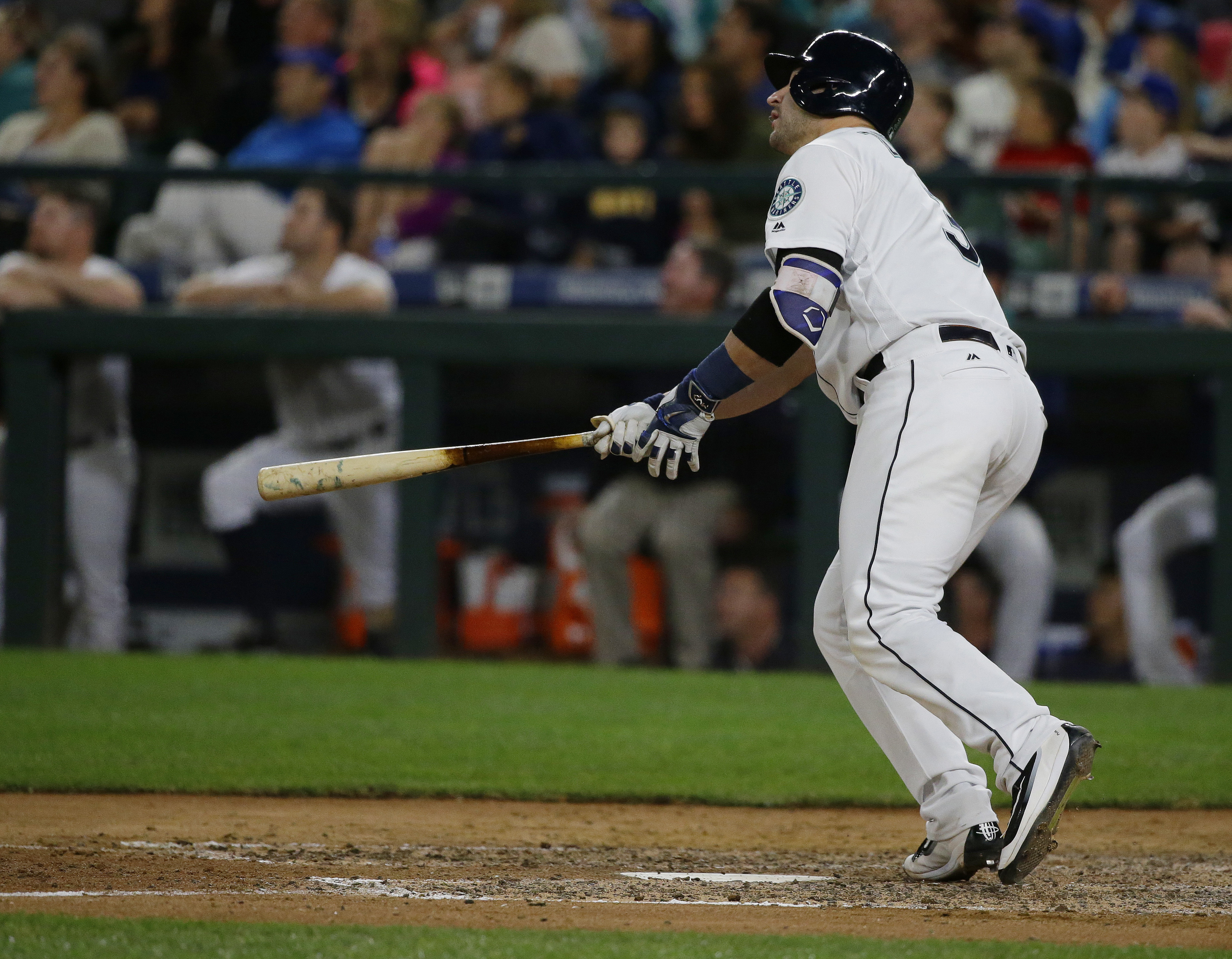 Seattle Mariners' Mike Zunino watches his three-run home run against the New York Yankees in the sixth inning of a baseball game, Monday, Aug. 22, 2016, in Seattle. (AP Photo/Ted S. Warren)