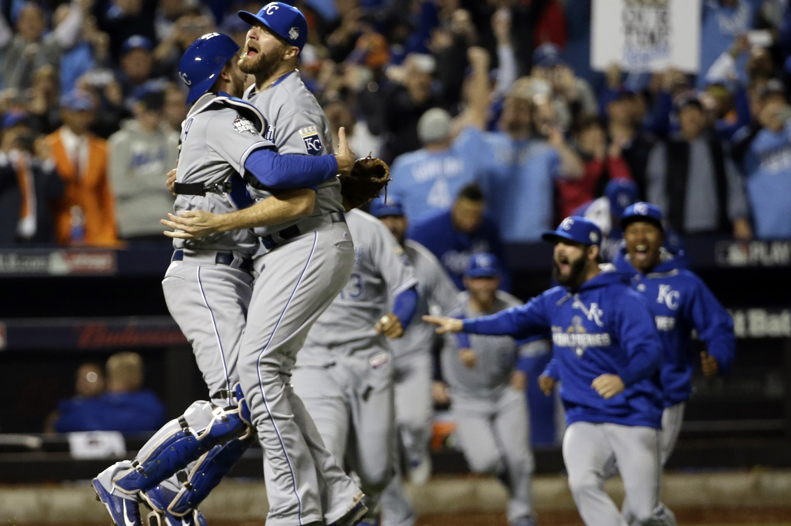 FILE - In this Nov. 2, 2015, file photo, Kansas City Royals catcher Drew Butera and Wade Davis celebrate after Game 5 of the team's baseball World Series against the New York Mets in New York. After winning 95 games, their first division title in three de