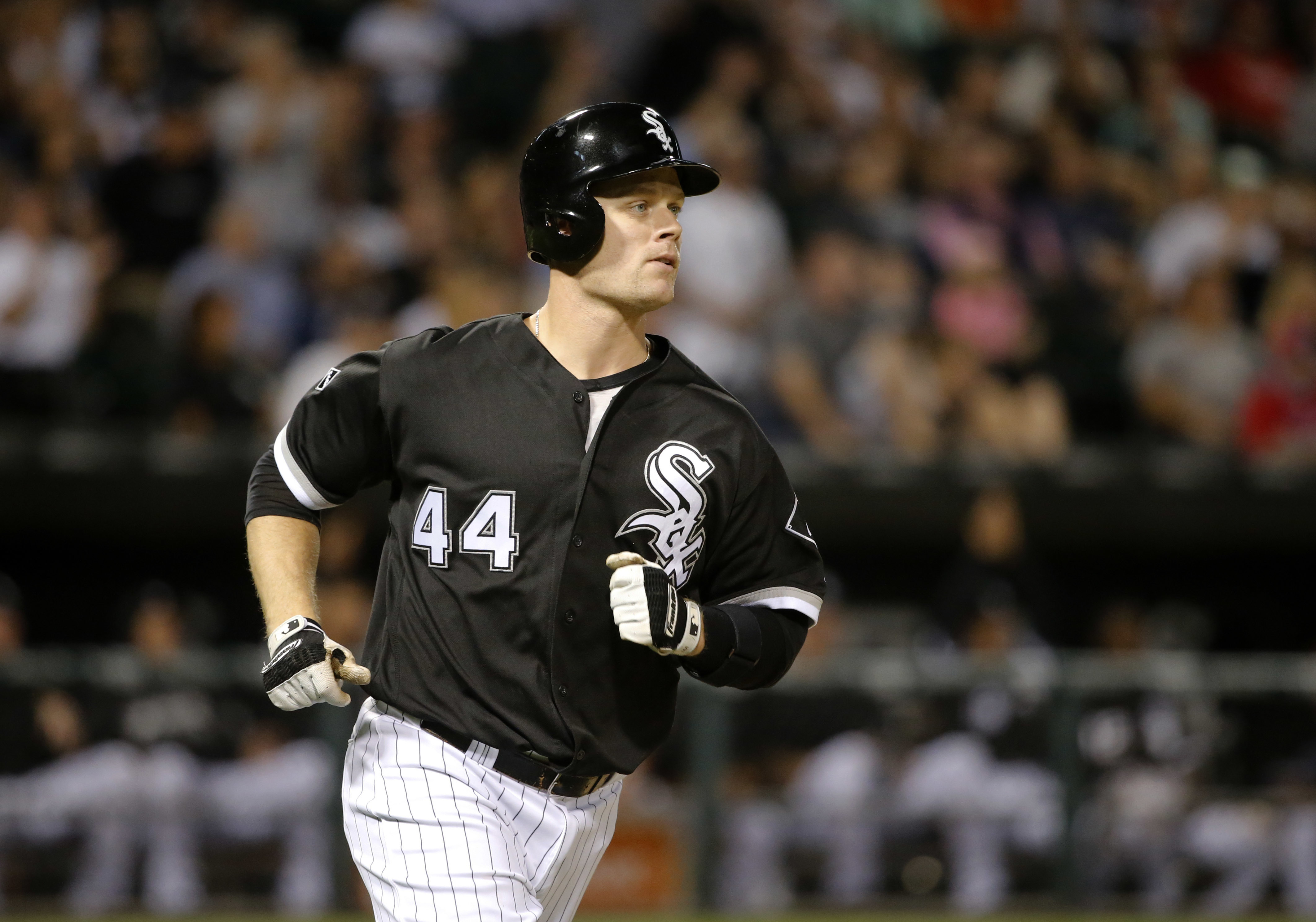 Chicago White Sox's Justin Morneau watches his home run off Philadelphia Phillies starting pitcher Jake Thompson during the fifth inning of an interleague baseball game Tuesday, Aug. 23, 2016, in Chicago. (AP Photo/Charles Rex Arbogast)