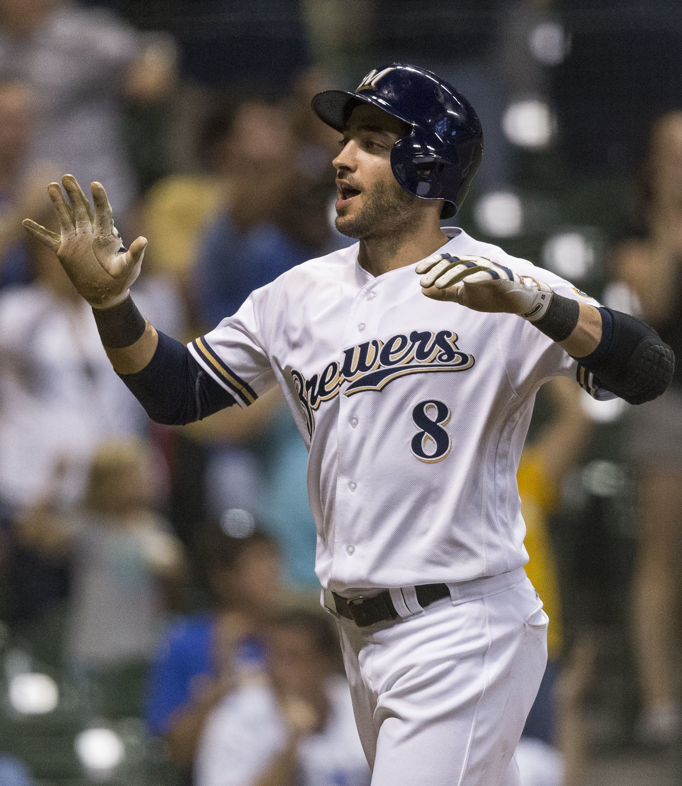 Milwaukee Brewers' Ryan Braun reacts to scoring on a Hernan Perez two RBI triple during the seventh inning of a baseball game Tuesday, Aug. 23, 2016, in Milwaukee. (AP Photo/Tom Lynn)