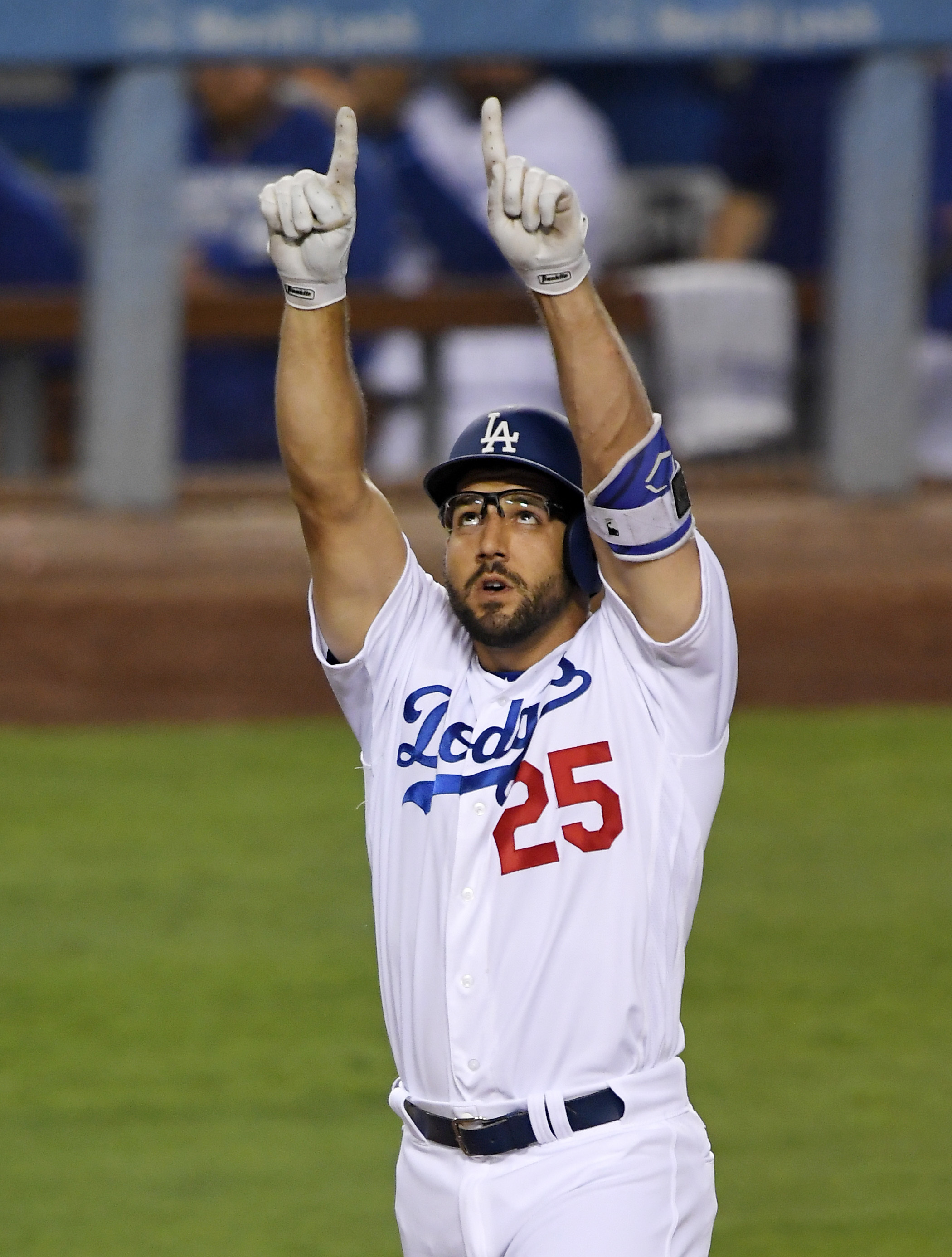 Los Angeles Dodgers' Rob Segedin celebrates after hitting a solo home run during the second inning of a baseball game against the San Francisco Giants, Tuesday, Aug. 23, 2016, in Los Angeles. (AP Photo/Mark J. Terrill)