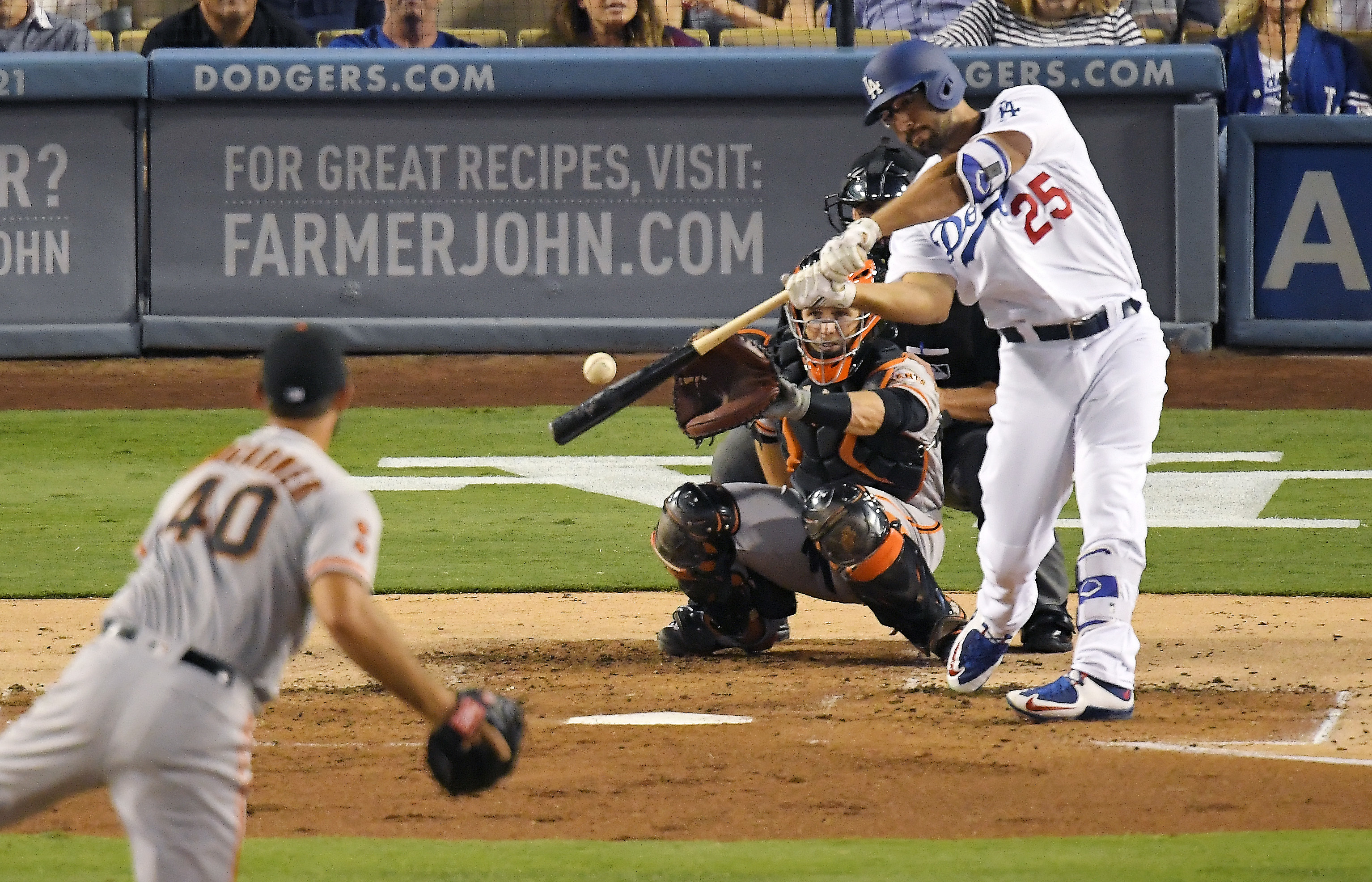 Los Angeles Dodgers' Rob Segedin, right, hits a solo home run off San Francisco Giants starting pitcher Madison Bumgarner, left, as catcher Buster Posey watches during the second inning of a baseball game, Tuesday, Aug. 23, 2016, in Los Angeles. (AP Photo