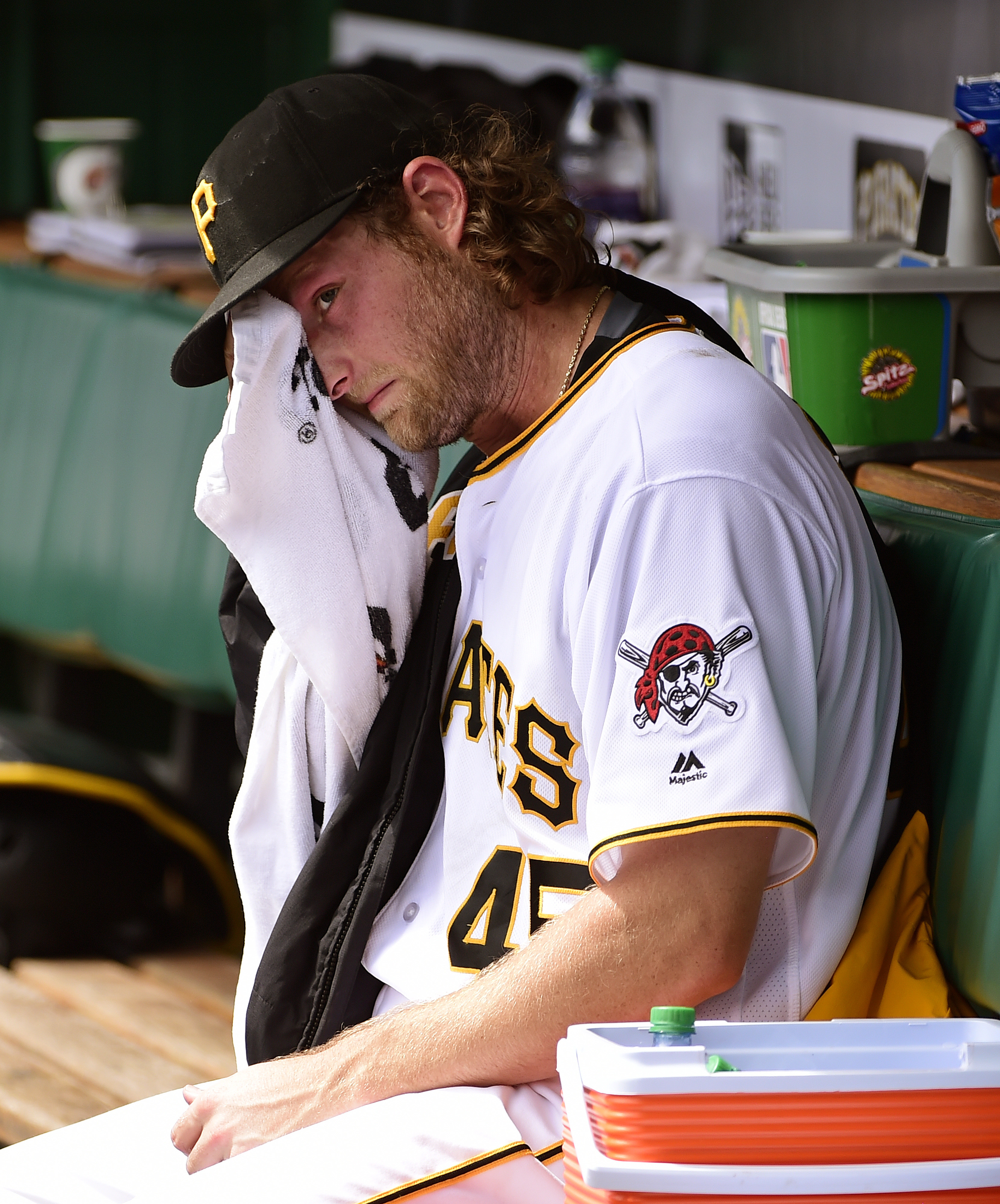 Pittsburgh Pirates' Gerrit Cole wipes his face in the dugout in the fourth inning of a baseball game against the Houston Astros in Pittsburgh, Wednesday, Aug. 24, 2016. (AP Photo/Fred Vuich)