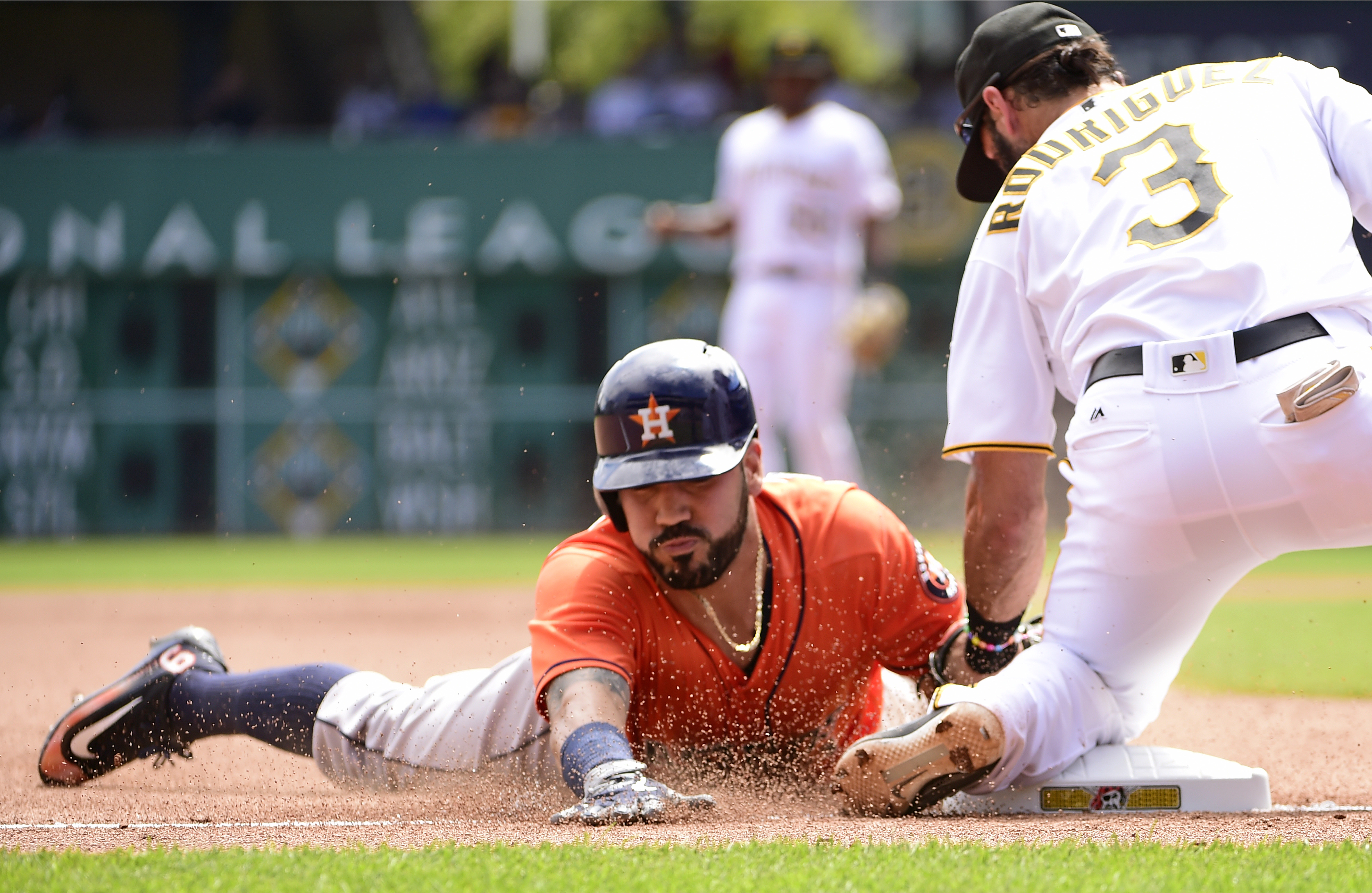 Houston Astros' Marwin Gonzalez slides safely into third with a triple as Pittsburgh Pirates' Sean Rodriguez applies a late tag in the fourth inning of a baseball game in Pittsburgh, Wednesday, Aug. 24, 2016. (AP Photo/Fred Vuich)