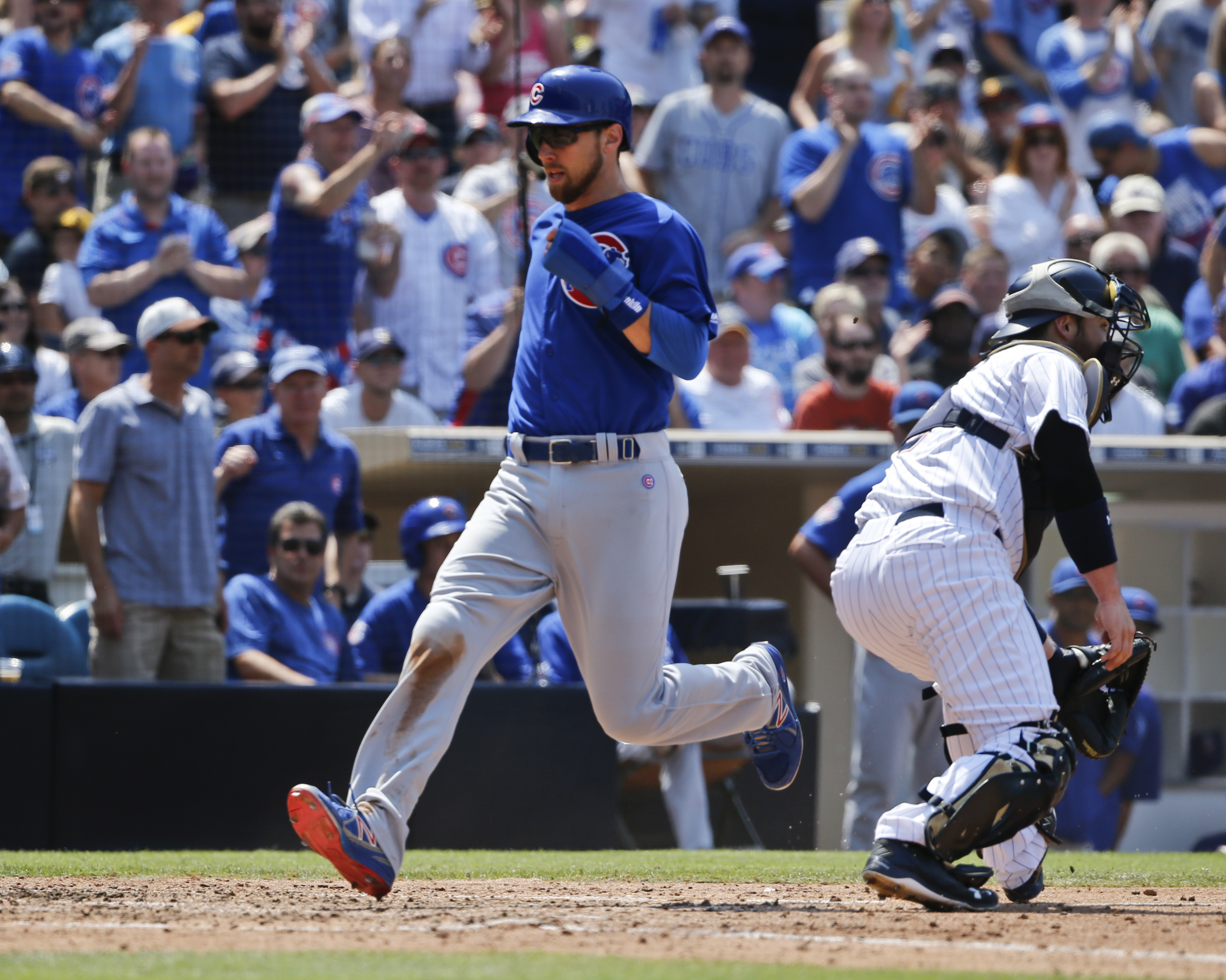 Chicago Cubs' Ben Zobrist races past San Diego Padres catcher Derek Norris while scoring in the sixth inning of a baseball game Wednesday, Aug. 24, 2016, in San Diego. Zobrist and Kris Bryant both scored on an error by Padres shortstop Luis Sardinas. (AP