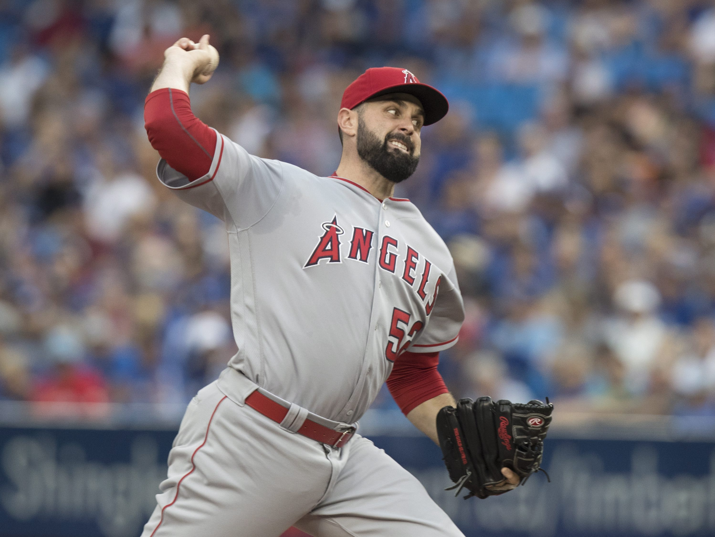 Los Angeles Angels starting pitcher Matt Shoemaker throws against the Toronto Blue Jays during the first inning of a baseball game Wednesday, Aug. 24, 2016, in Toronto. (Fred Thornhill/The Canadian Press via AP)
