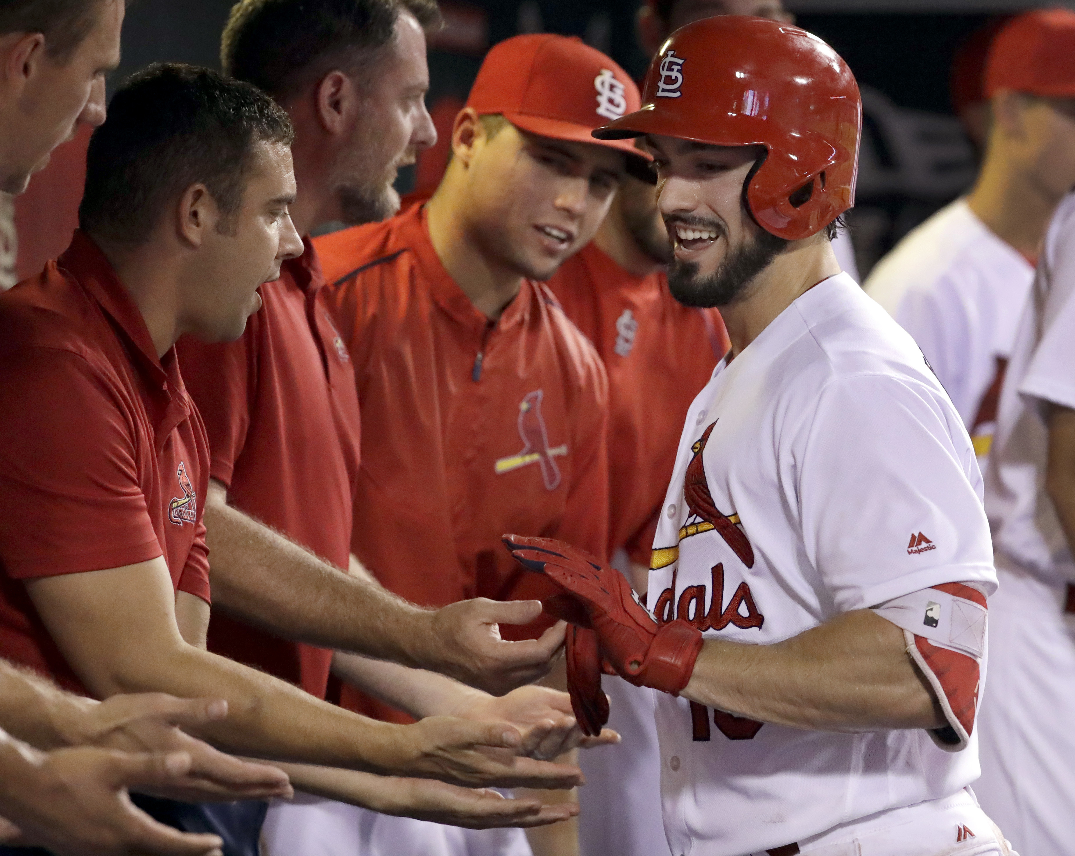 St. Louis Cardinals' Randal Grichuk is congratulated by teammates after hitting a solo home run during the fourth inning of a baseball game against the New York Mets on Wednesday, Aug. 24, 2016, in St. Louis. (AP Photo/Jeff Roberson)