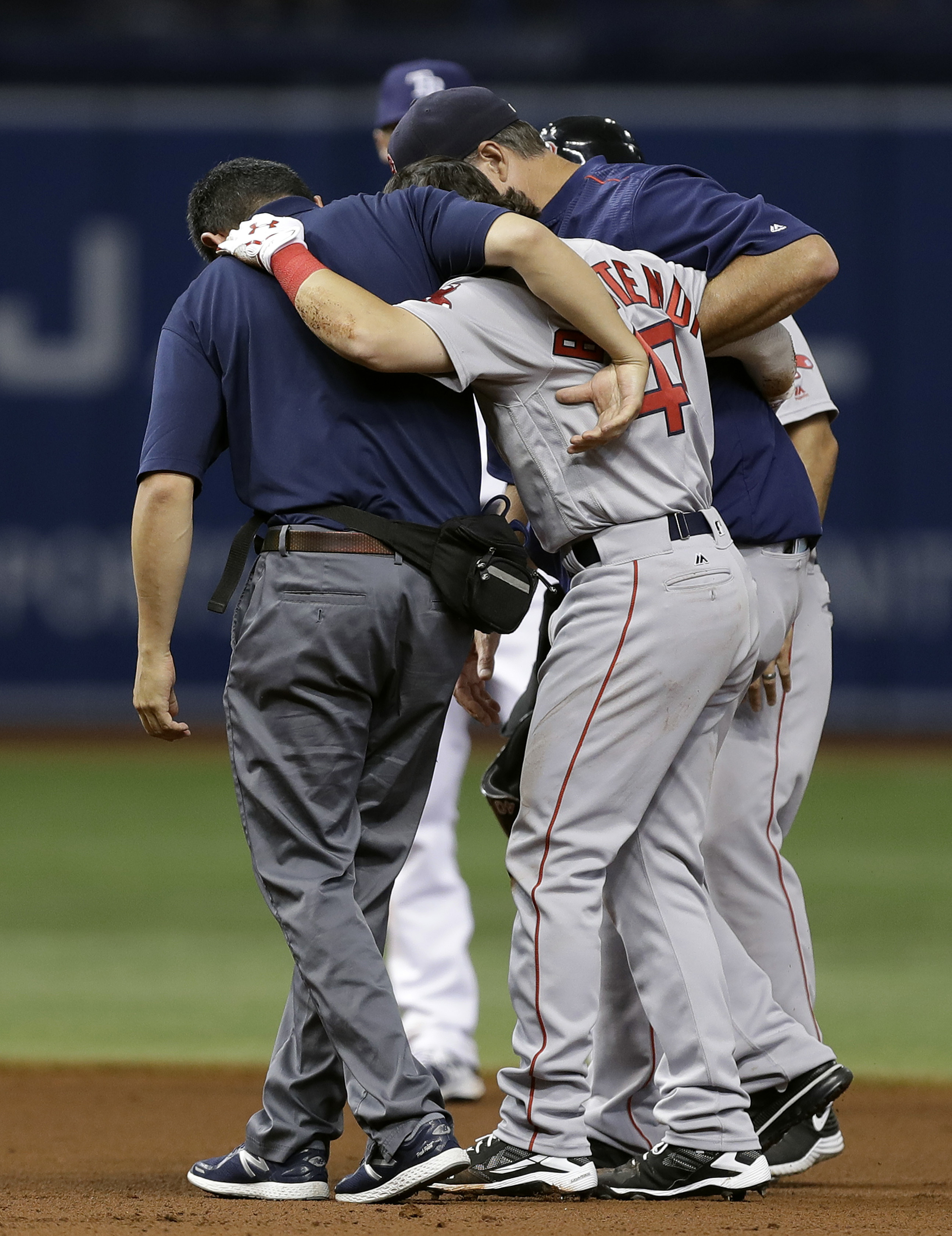 Boston Red Sox's Andrew Benintendi (40) is helped from the field after getting injured while being involved in a double play during the seventh inning of a baseball game Wednesday, Aug. 24, 2016, in St. Petersburg, Fla. Benintendi left the game. (AP Photo